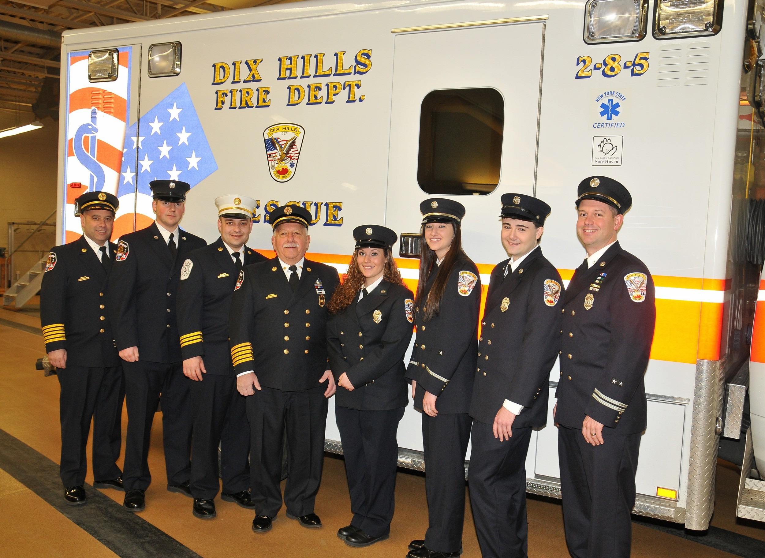 Pictured from left, Dix Hills Chief Bill Stio, Matt Stio, Assistant Chief Tom Napolitano, Ex-Chief Richard Sorrentino, Megan Pereira, Jessica Mattes, John Marshall and Scott DiPino were recently honored for rescuing a 60-year-old man in cardiac arrest. Not pictured, but honored, were Mike Englander, Travis Mielko and Ralph Oswald. (Photo by Steve Silverman)
