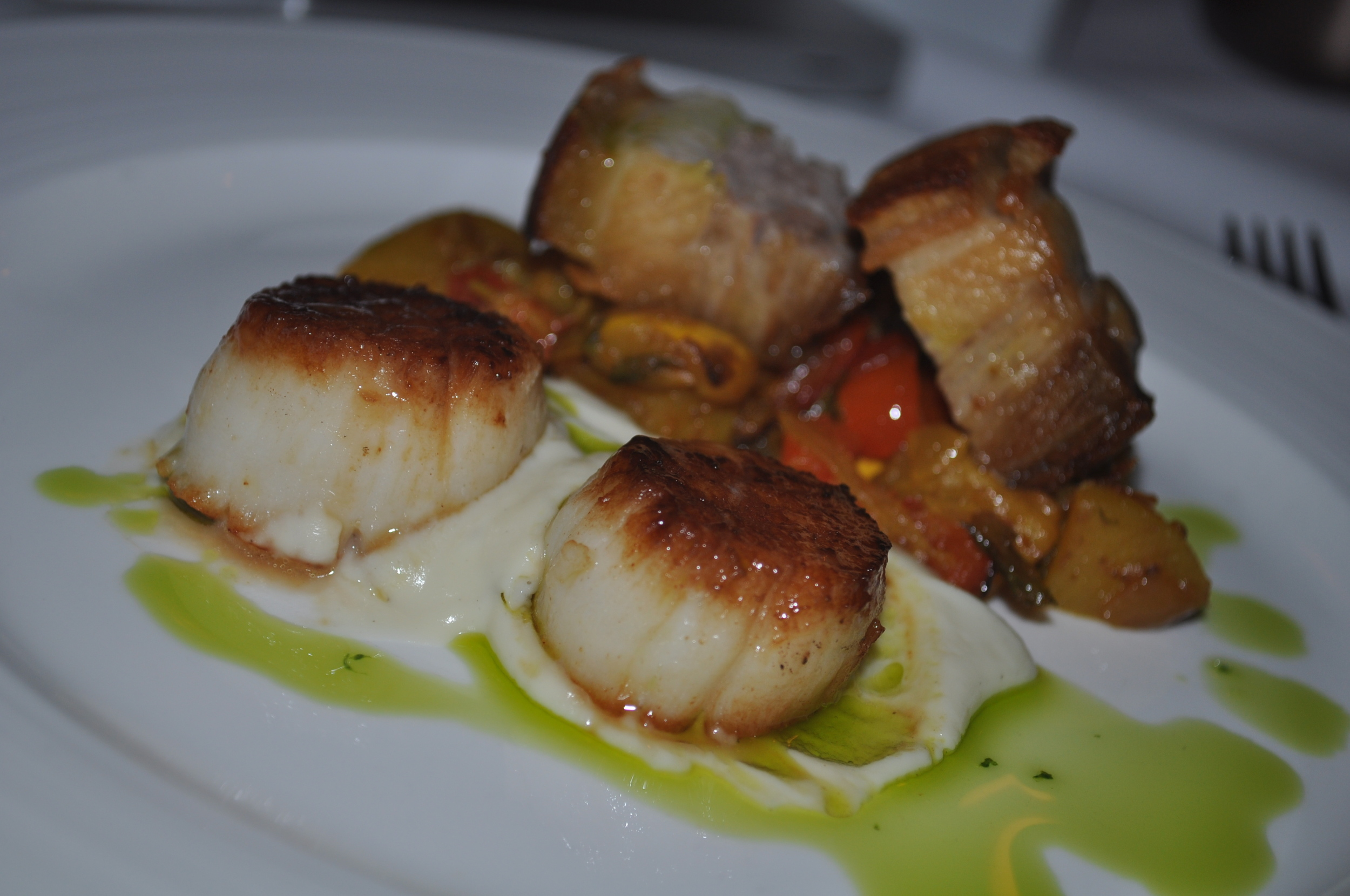 A Different Surf & Turf pairs scallops and pork belly.