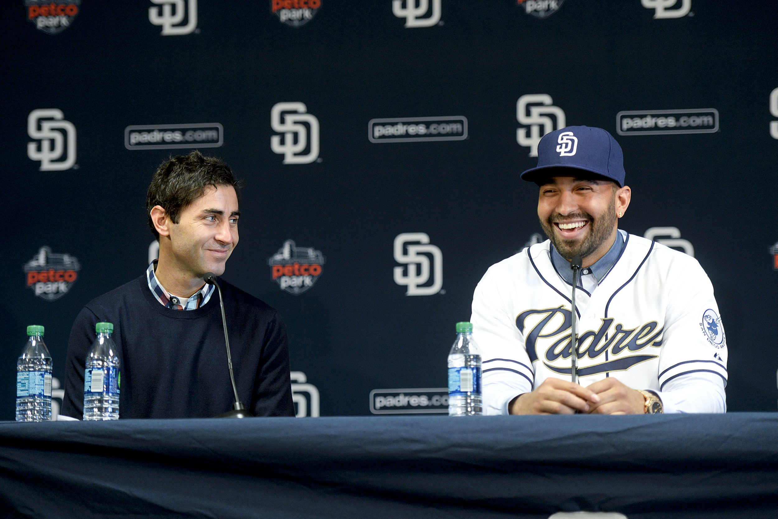 A graduate of Walt Whitman High School and now general manager of baseball's San Diego Padres, A.J. Preller, left, is pictured during a press conference where it was announced the team traded for all-star outfielder Matt Kemp, right.