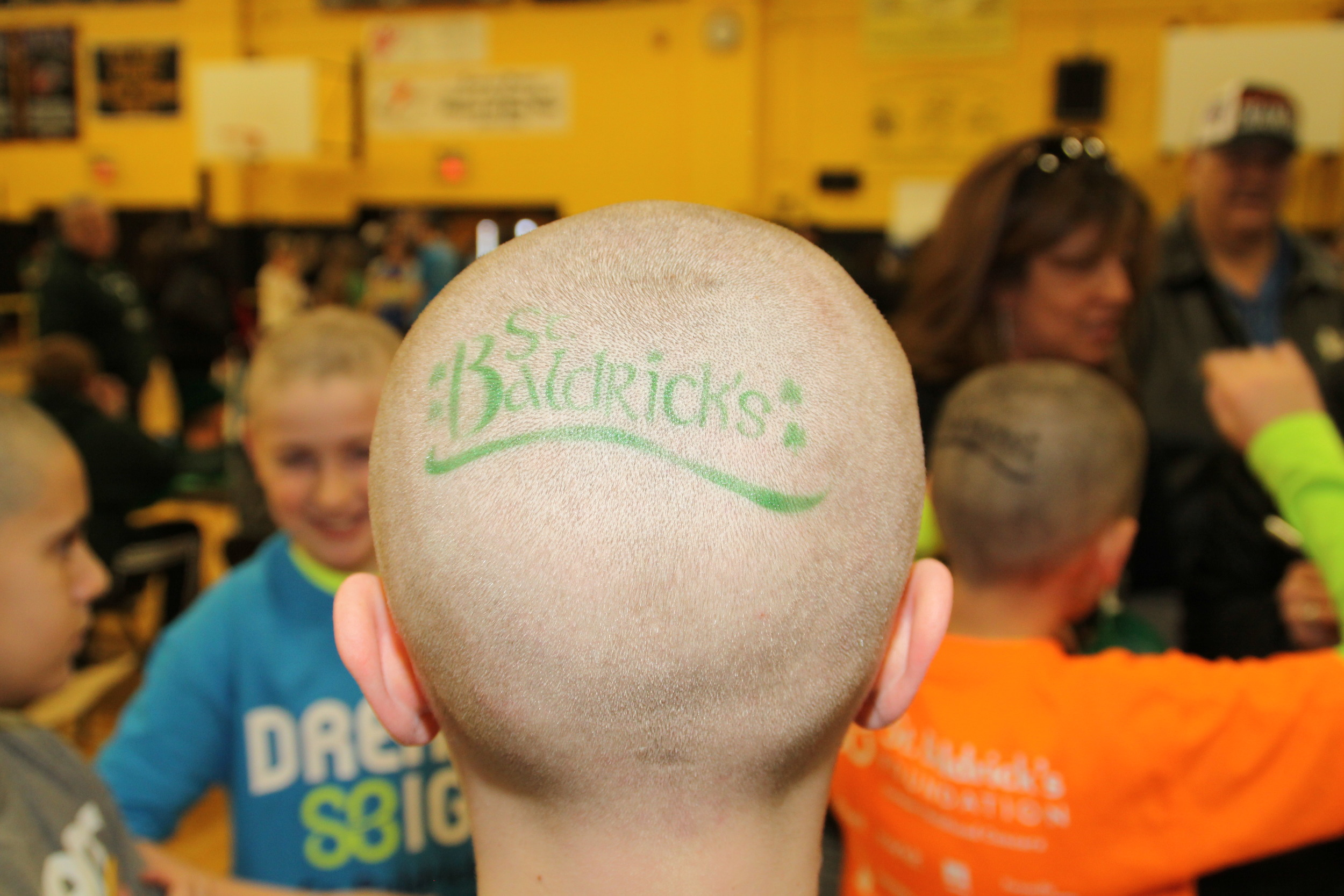 "Bald heads were a common sight at Commack High School on Friday as 250 ""shavees"" made their way out to the school to have their heads shaved as a part of the town's annual St. Baldrick's event."