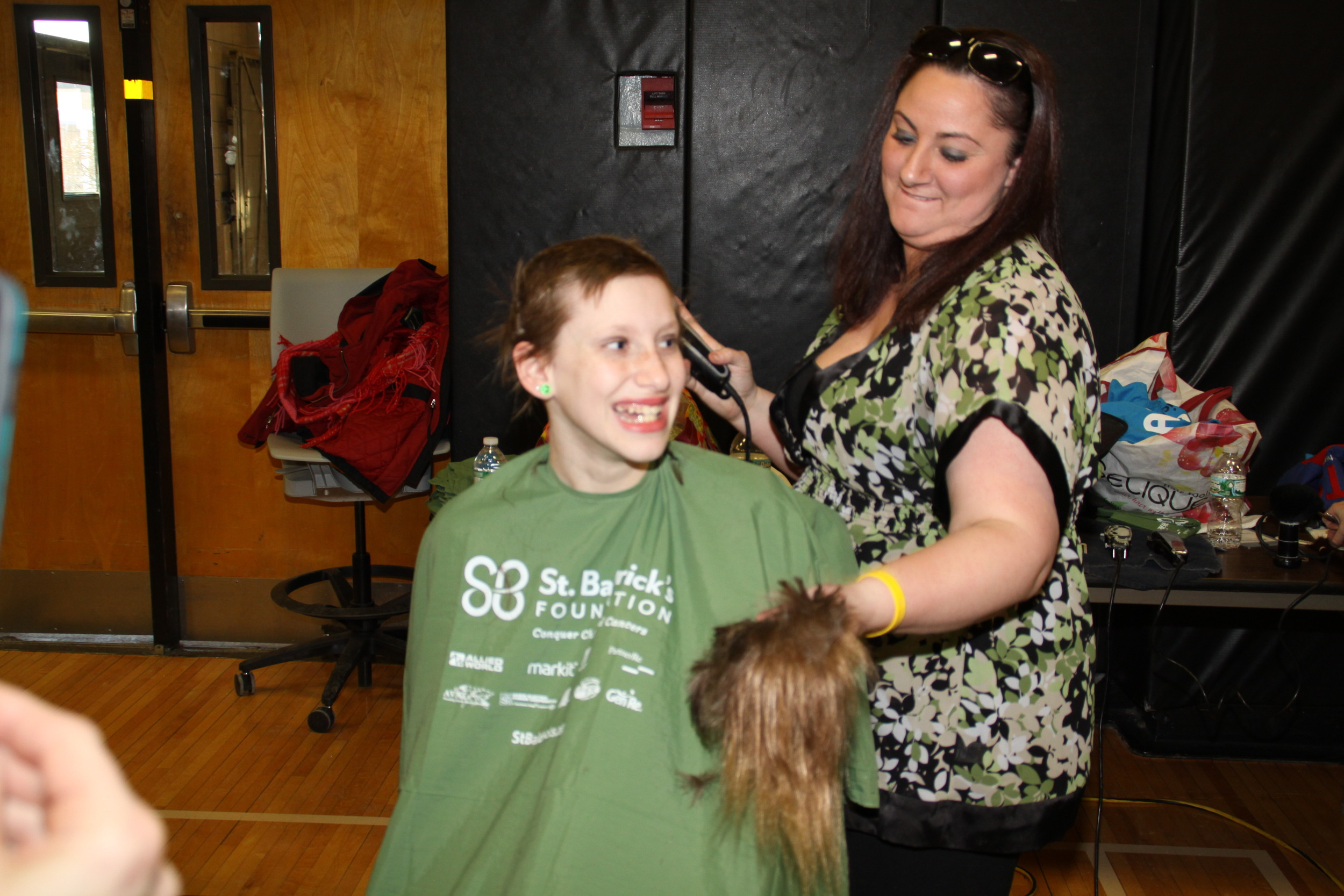 Madison Adelman, an 11-year-old and student of Commack Middle School, is one of several girls that shaved their heads on Friday as a part of the district's annual St. Baldrick's fundraiser.