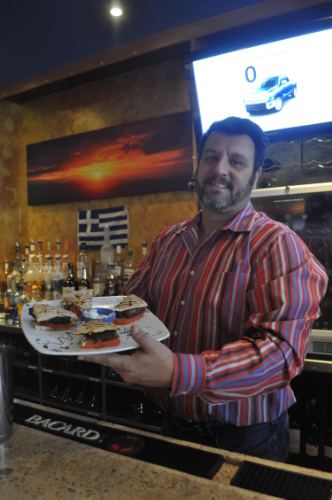Neraki owner Alex Moschos displays the Yia Yia sandwich, one of many available on Neraki's $9.95 lunch sandwich menu.