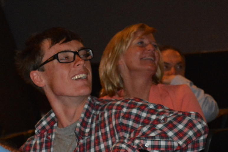 "Mikey Brannigan, left, and his mother Edie, right, smile after the conclusion of ""The Silent Portrait of Michael Brannigan,"" a documentary exploring the life of the Northport runner's accomplishments and his dealings with autism."