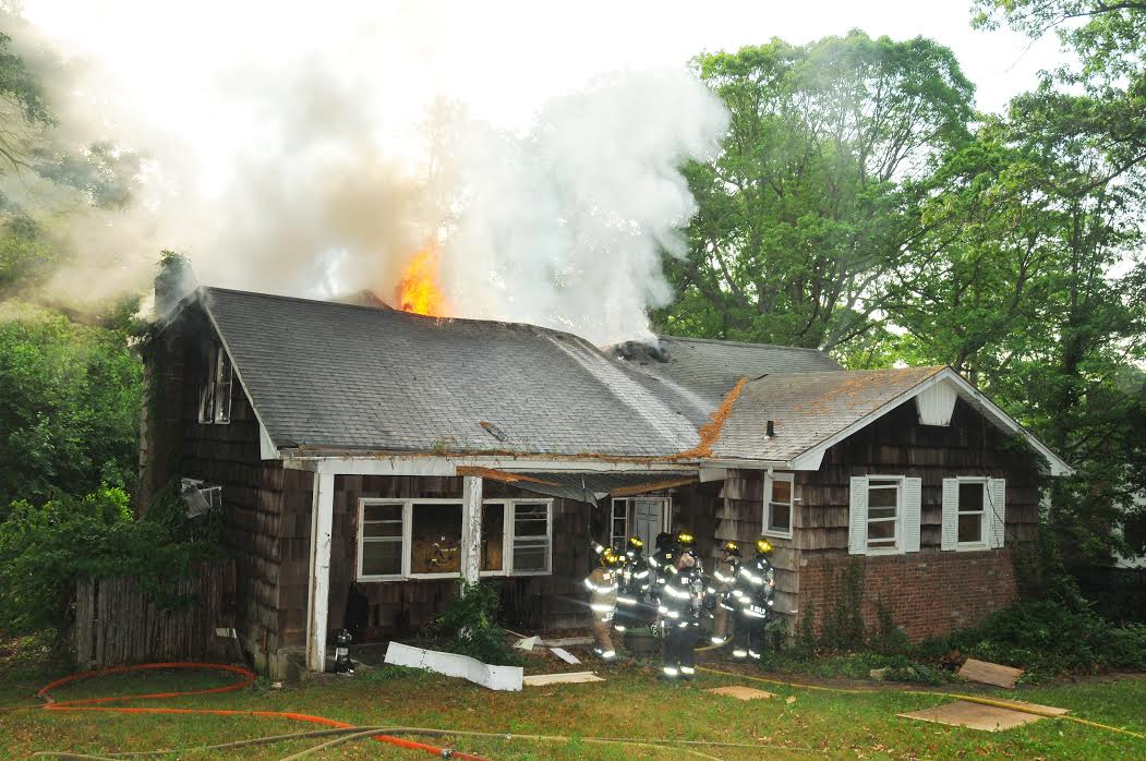 """An early-morning fire that badly damaged 4 Carriage Court in Dix Hills, a blighted home, has been deemed """"suspicious,"""" town officials said. (Photoby Steve Silverman)"""