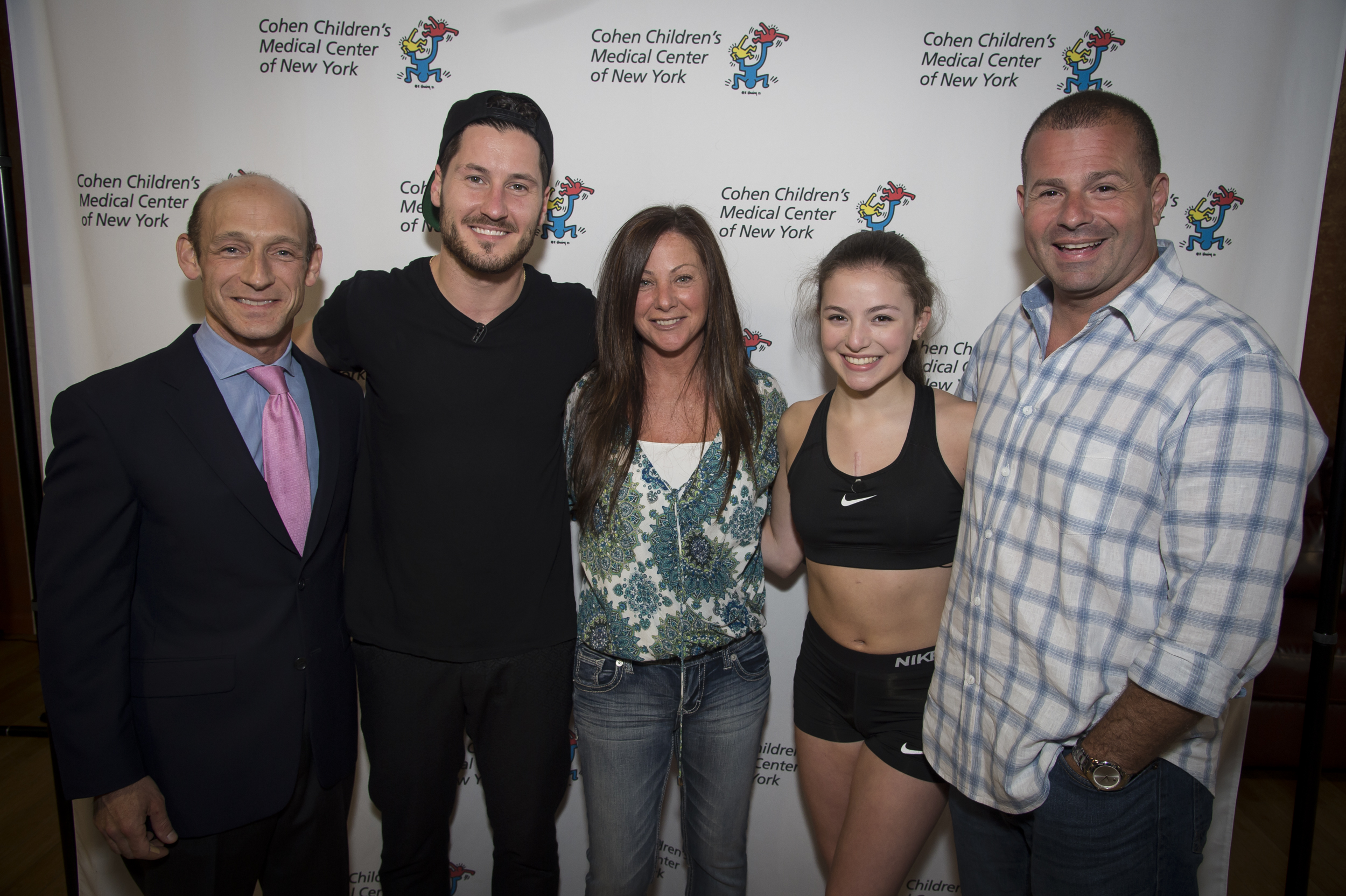 National Dance Champion and open-heart surgery survior Gianna Schupler stands between her parents, Maria and Phil, with the heart surgeon who saved her, Dr. David Meyer, on the left and her dance idol, Val Chmerkovskiy, on the right.