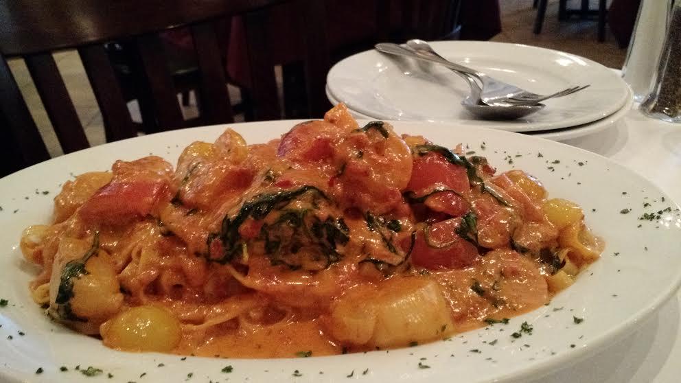 Fettucine de Mar pairs al-dente pasta, a light pink cream sauce and fresh seafood.