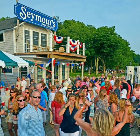 Hundreds packed Seymour's Boatyard Sunday night for the second annual Rock on the Dock fundraiser, raising $11,000 for the Cow Harbor Warriors – and the irritation of a neighbor who called a noise complaint into village police. (Photo by Dave Tuohy)