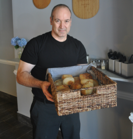 Al Salese, owner of Eatalia in Huntington village, displays home-made sea-salt Italian bread fresh from the oven from the 34 New St. family-style restaurant.