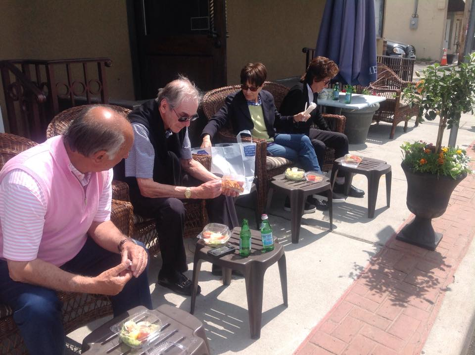 Patrons enjoying 'The Stoop' at Tutto Pazzo.