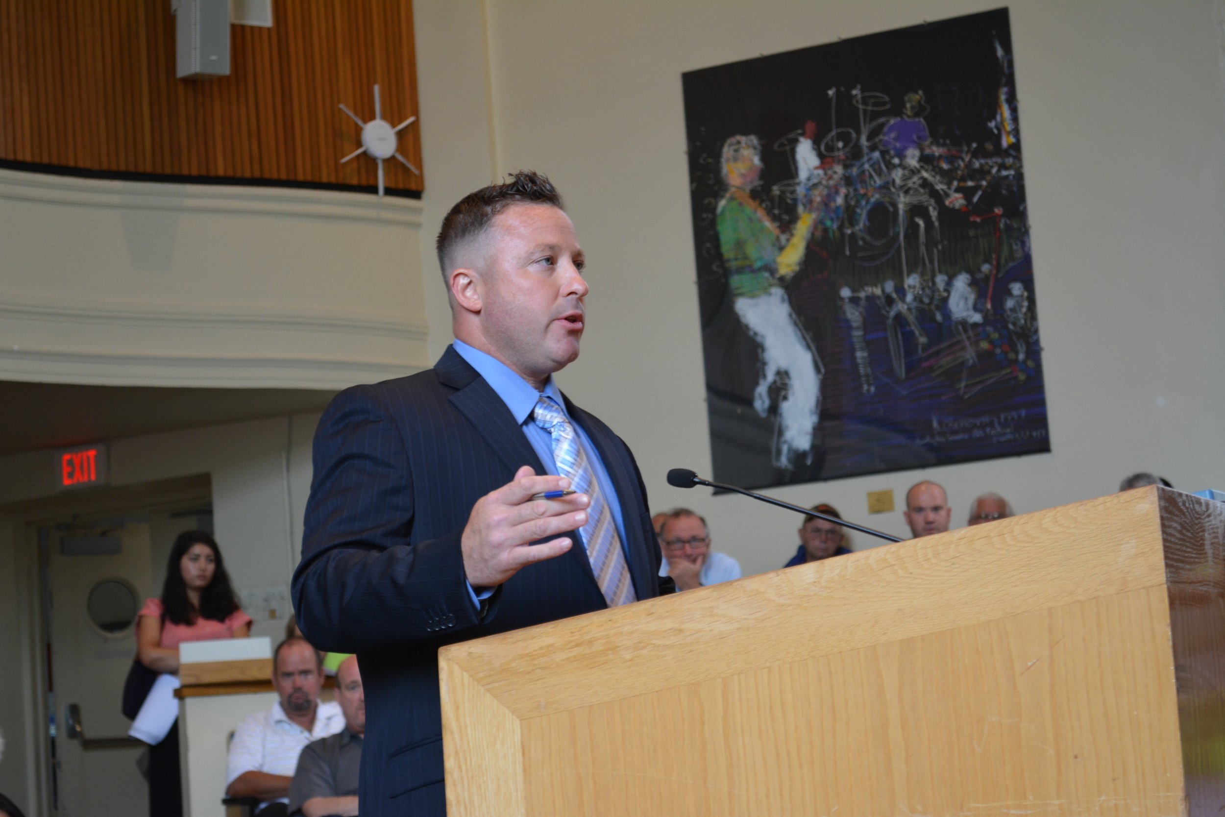 Michael Tessitore, president of Hunters For Deer, speaks at Tuesday's town board meeting about a proposal that would allow for in-season longbow deer hunting on private properties in Asharoken and Eatons Neck.