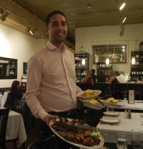 Ravagh owner Matt Tazari displays kebob platter (jujeh kebob, koobideh kebob and barg kebob) with basmati rice.