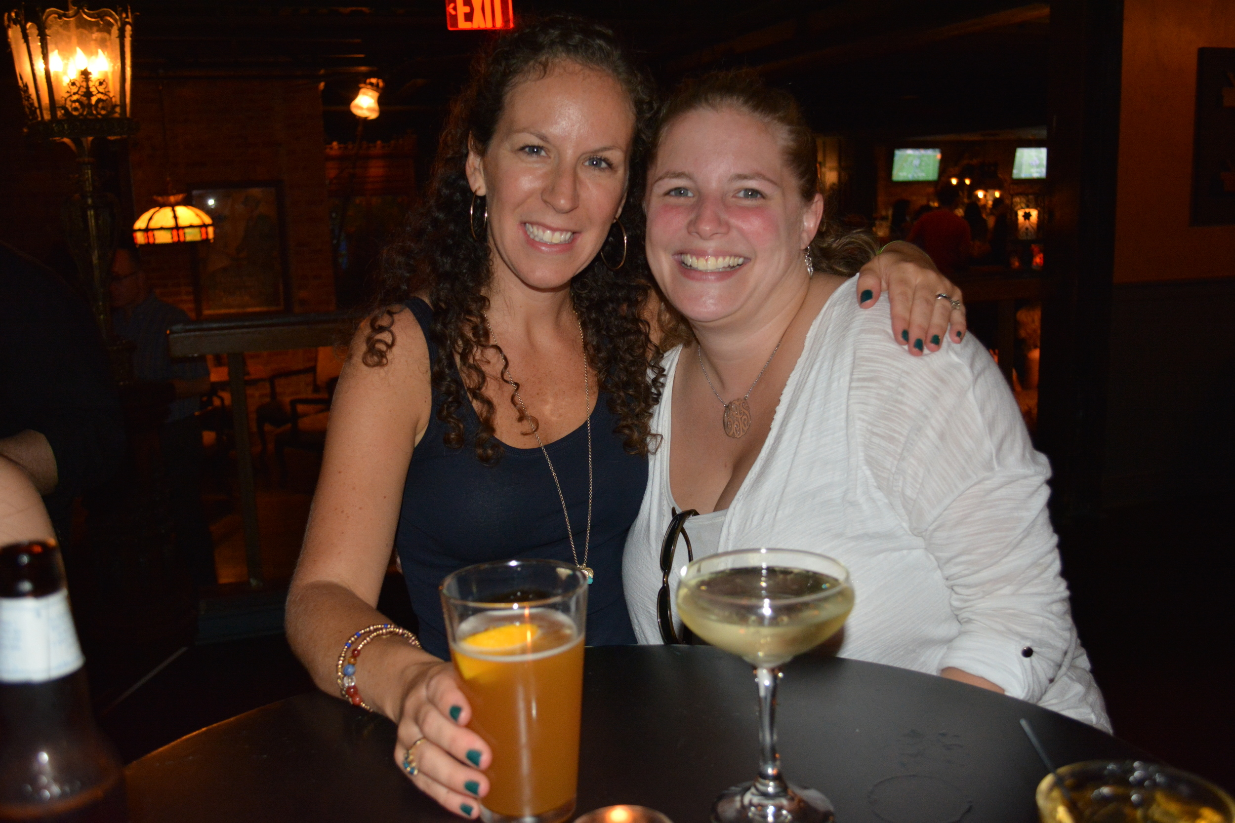 Alanna Russo, of East Northport, enjoys a drink with Claudia S. Fortunato-Napolitano, executive director of the Huntington Historical Society, in the Founder's Room of The Paramount, one of two stops during Sept. 3 walking tour and pub crawl.