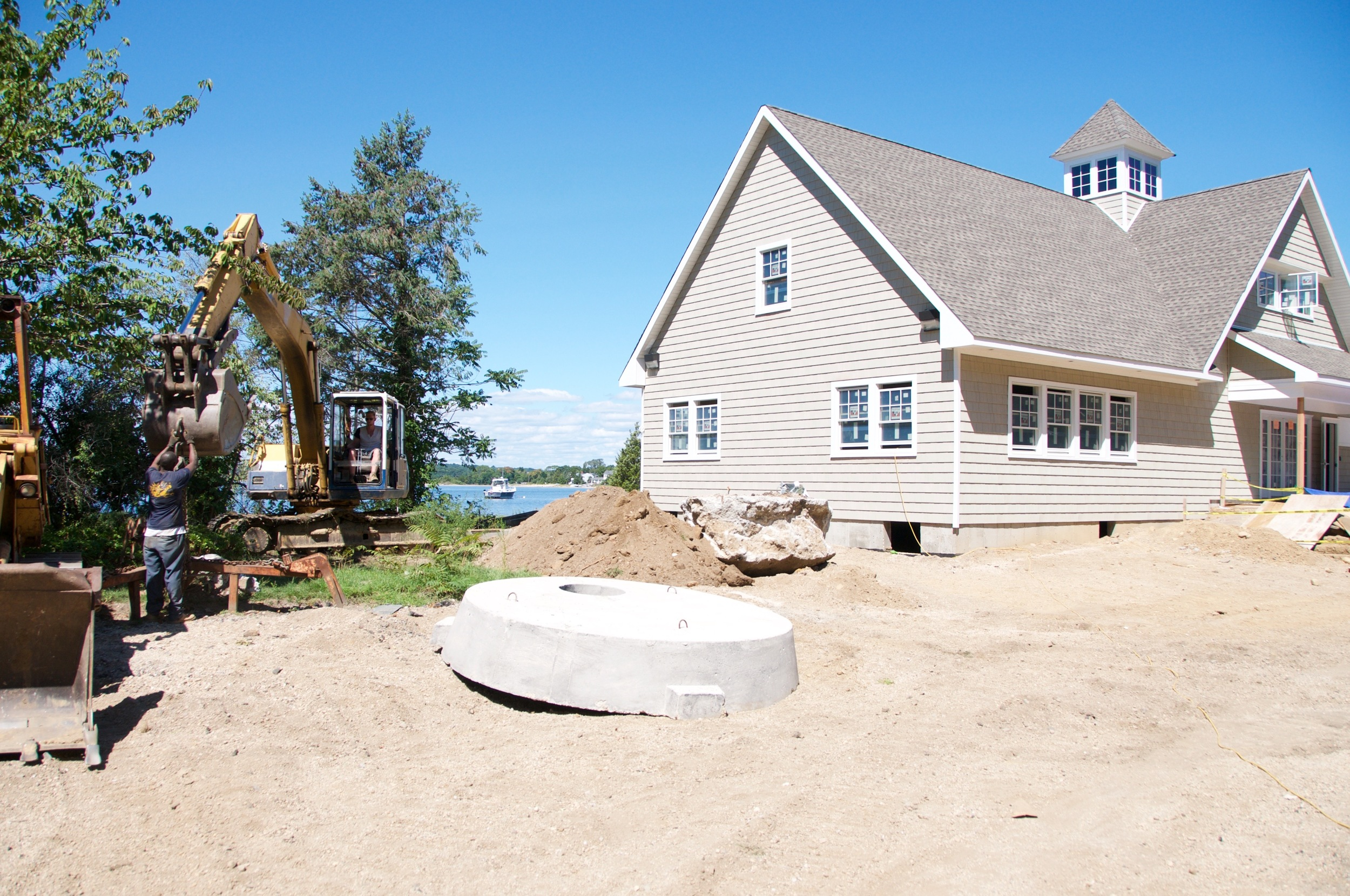 Asharoken's new Village Hall is still under development, with its opening delayed until mid-October due to an unexpected drainage pipe issue.