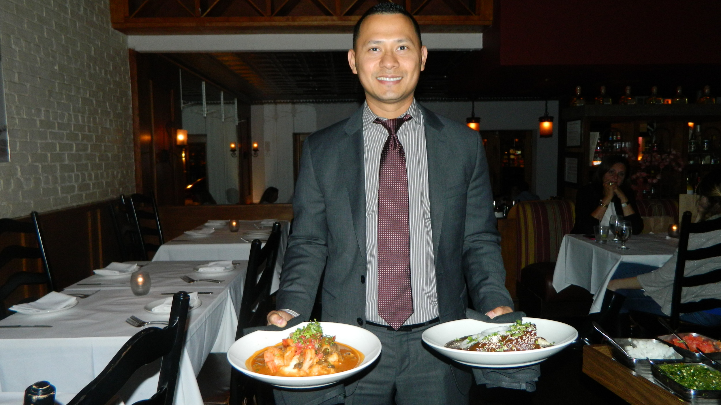 Manager Jose Reyes presents enchilades de mole poblano and camarones ajilo.