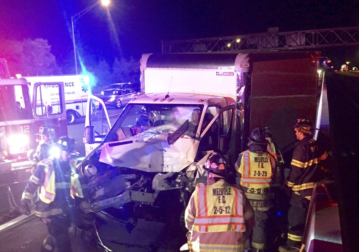 The Melville Fire Department responds to an accident involving two trucks at exit 48 of the Long Island Expressway early Monday morning. (  Photo/Melville Fire Department)