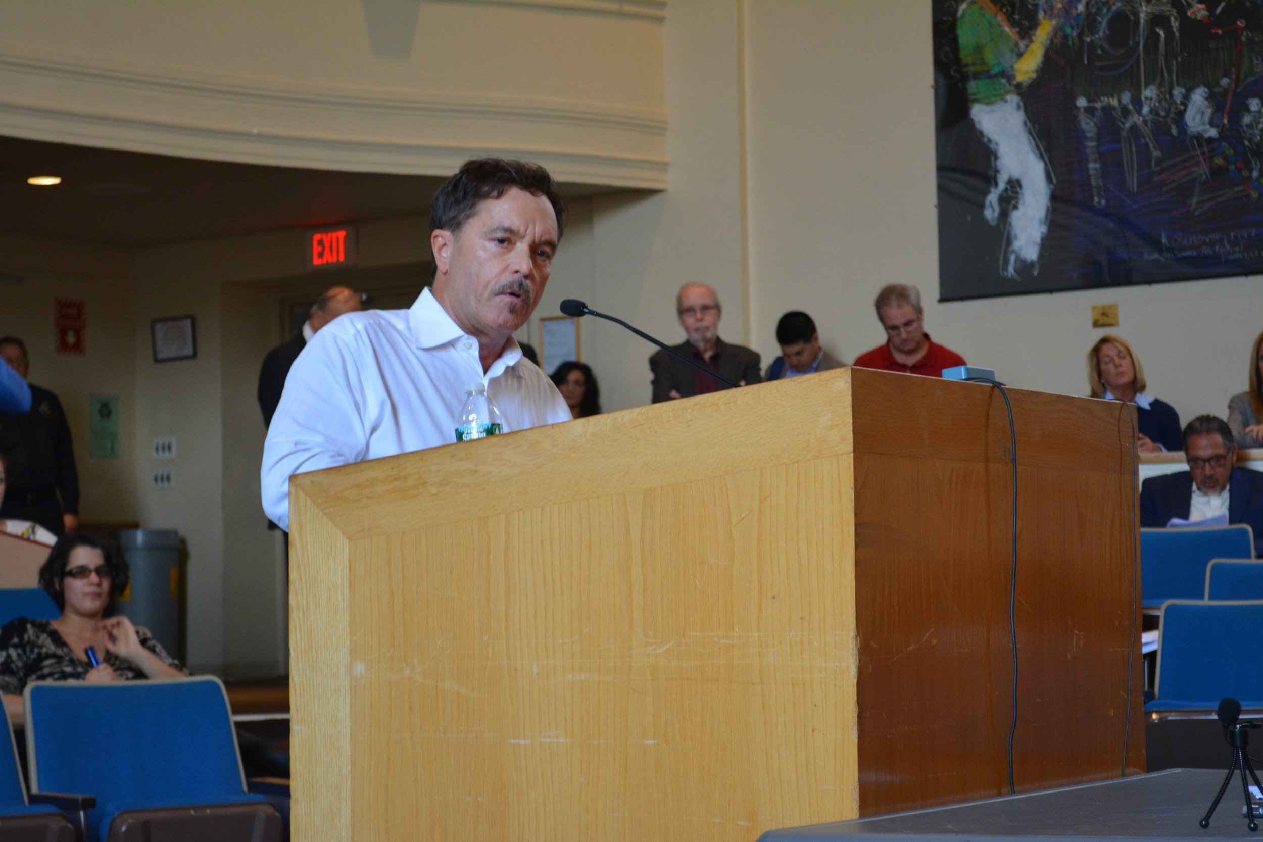 Robert Holmes, of Asharoken, speaks during the Nov. 6 Huntington town board meeting against a proposal calling for an oversized dock planned to extend off of a 22-acre Duck Island property in Asharoken. The proposal was approved by the   board 4-0.
