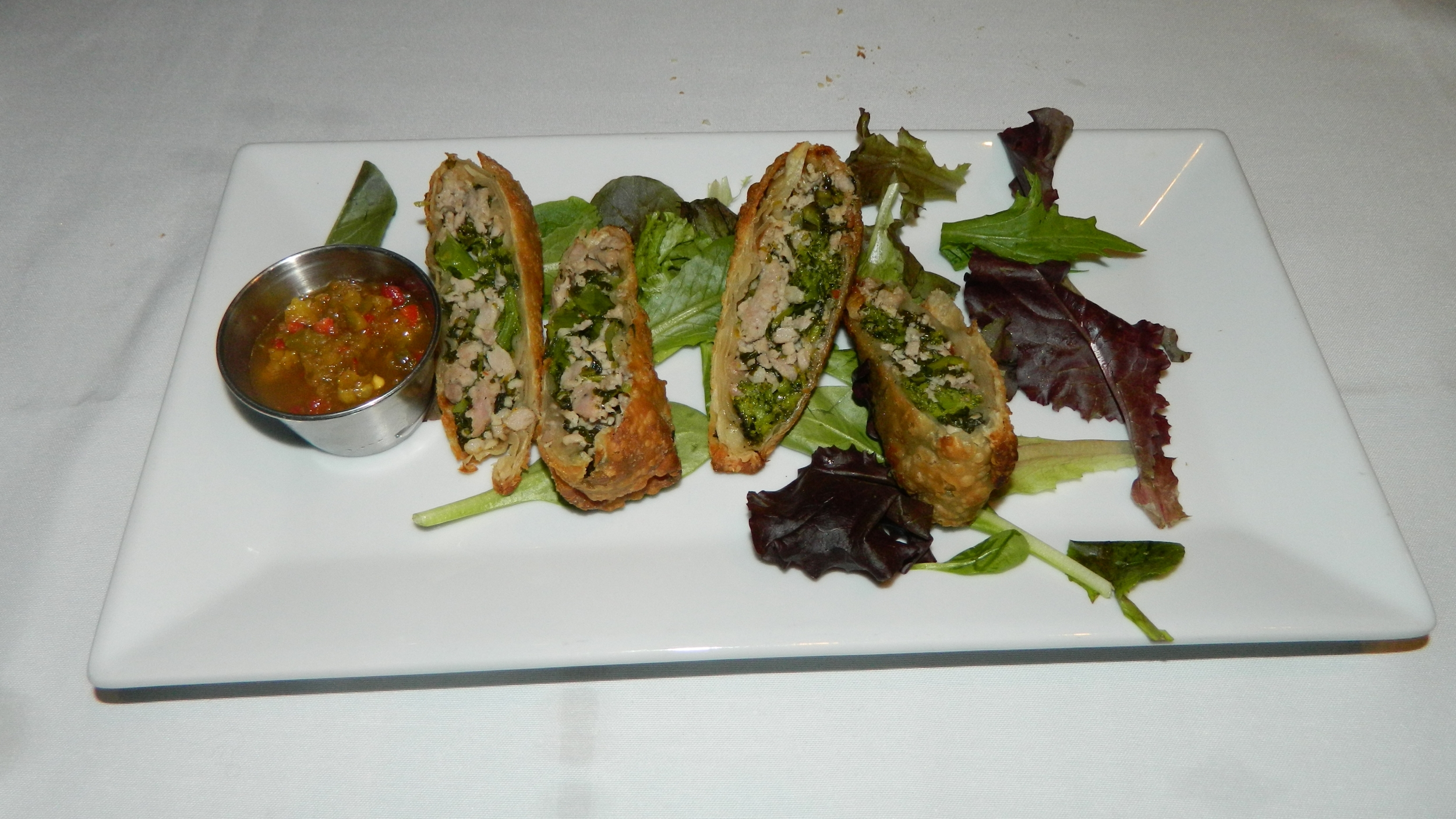 The broccoli rabe and sausage egg rolls with spicy Italian chimichurri sauce is an excellent appetizer.