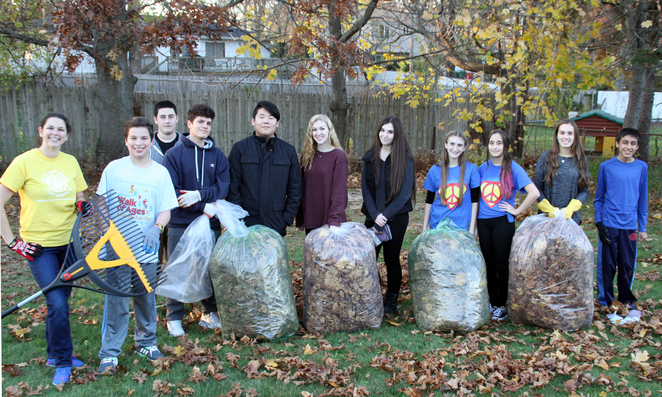 """Commack High School's Pay it Forward club """"raked-it-forward"""" last week as part of the club's annual effort to rake and collect leaves for seniors in the community."""
