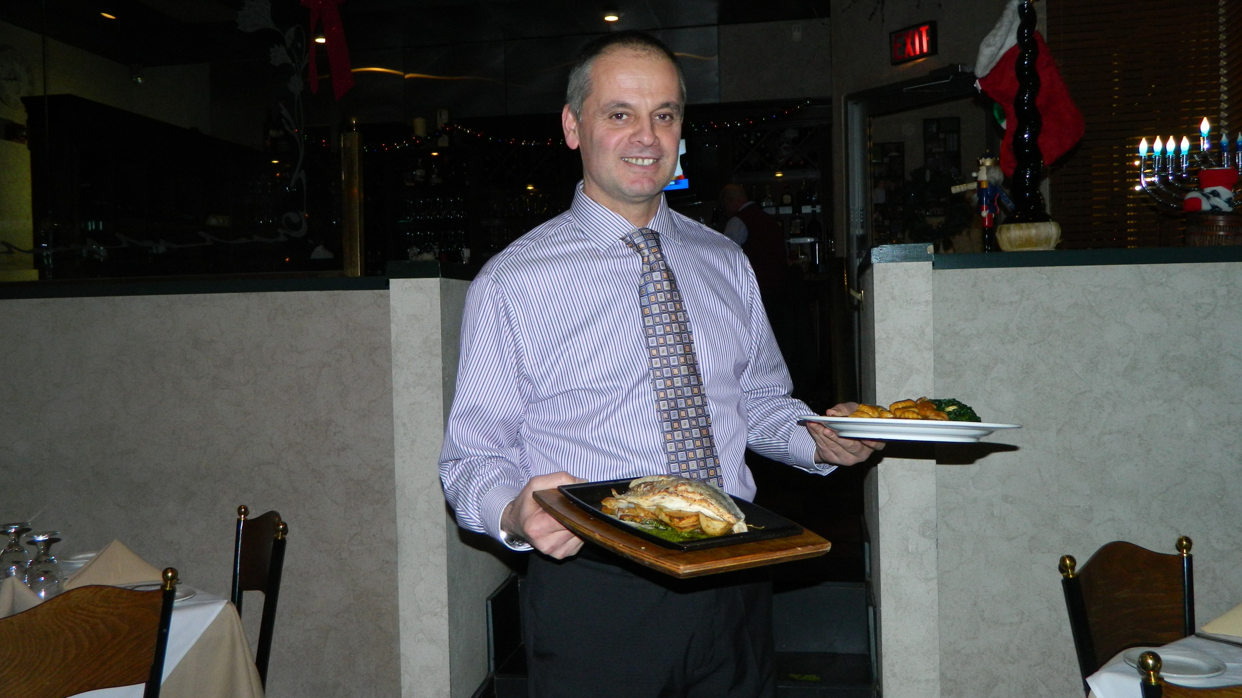 Roland Mizaku presents veal saltimbocca and branzino entrees.
