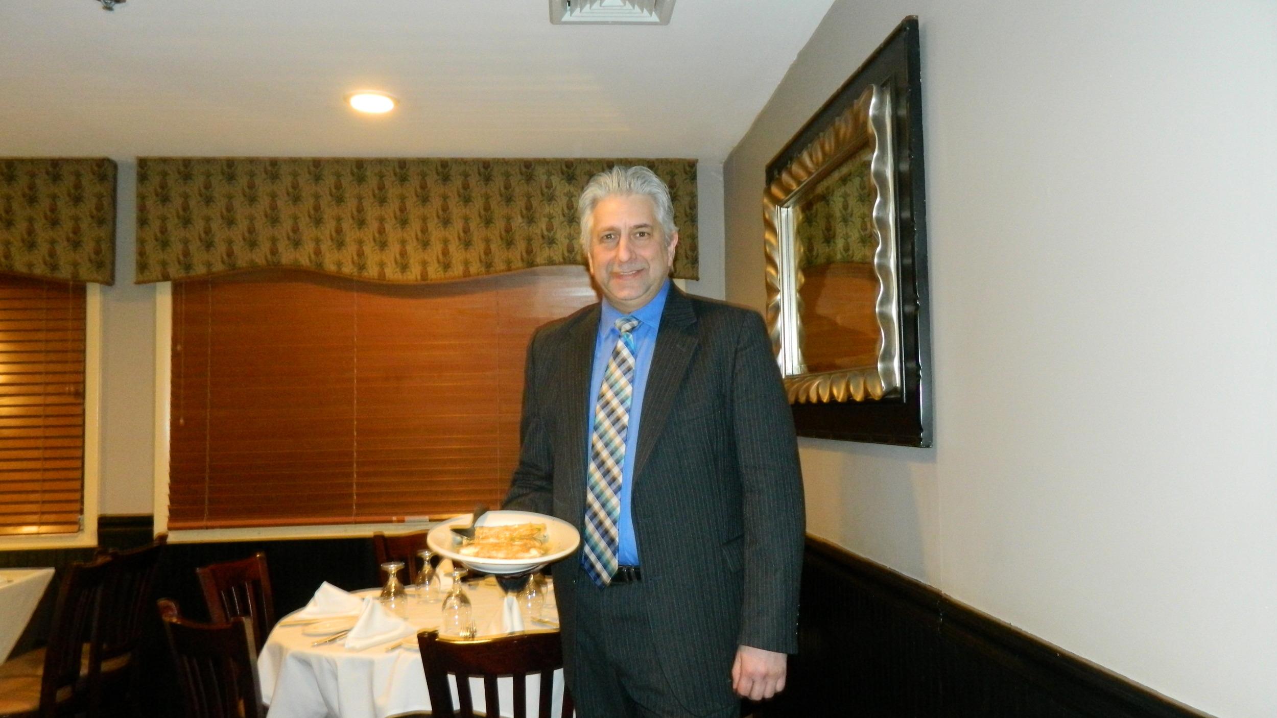 Owner John Lubrano presents Piccola Bussola's Lobster Ravioli entree.