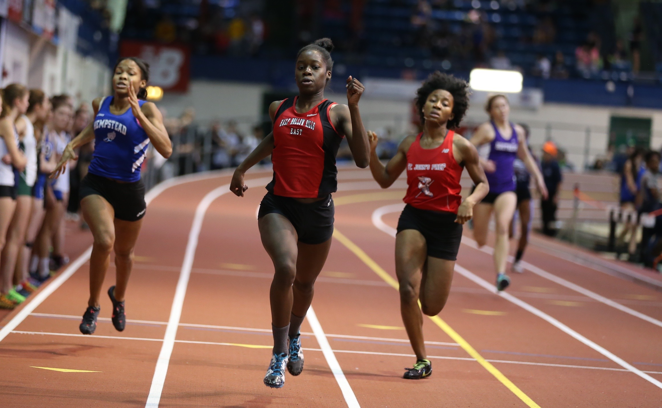 Mary Chimezie, a High School East senior, races the 300-meter at the Molloy Stanner Games in Manhattan earlier this month. She finished in 39.49 seconds, which is the fifth-fastest time in the country this winter season.