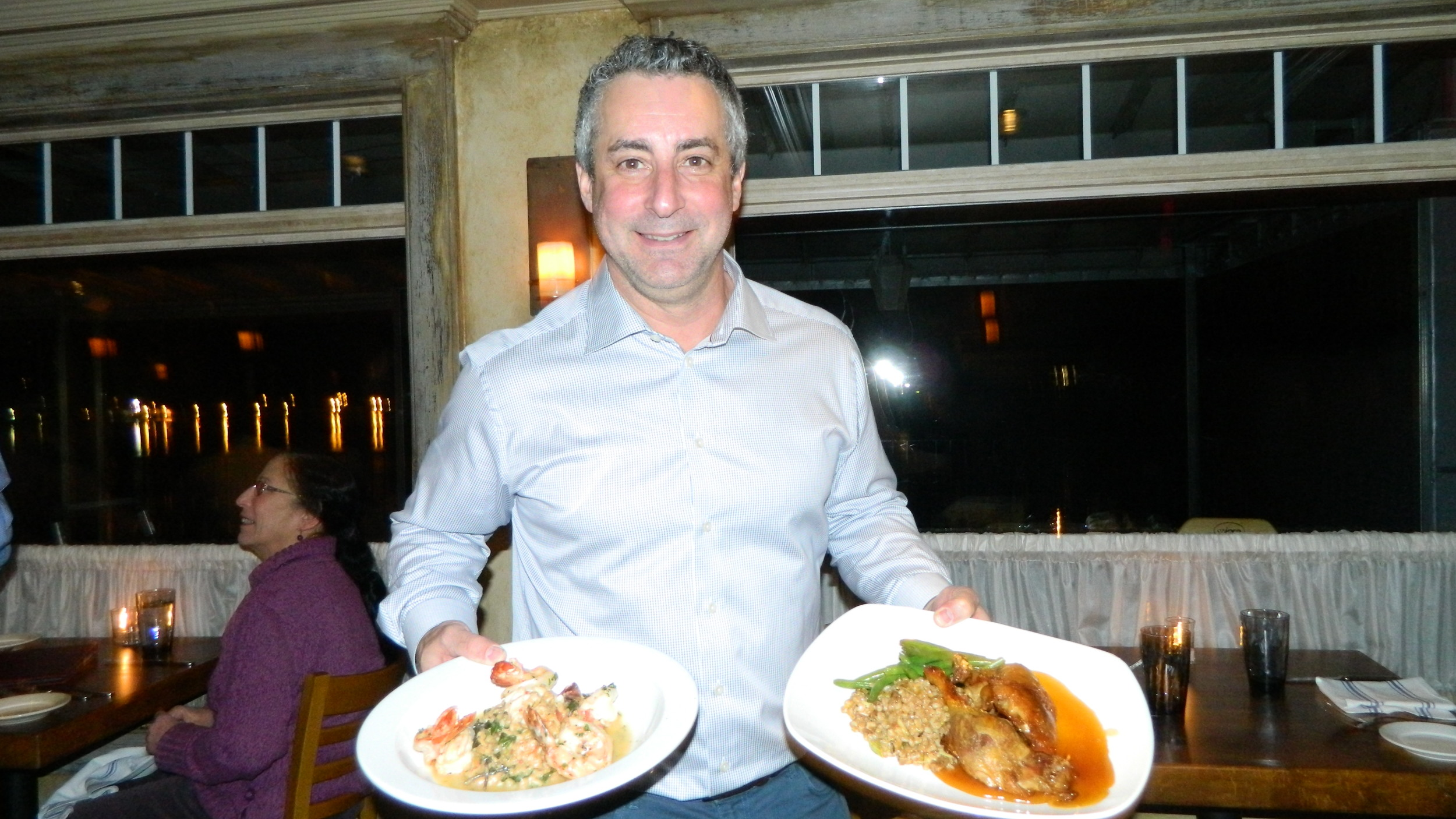 Dean Philippis, Mill Pond House owner, presents shrimp scampi and crispy duck.