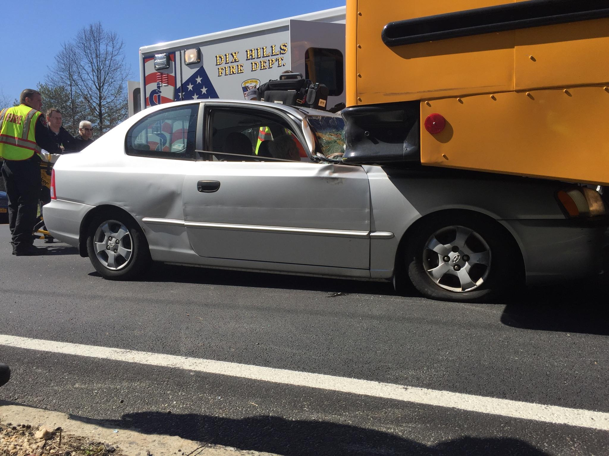 Suffolk   police and fire officials said a 91-year-old Wheatley Heights man crashed his car into a school bus in Dix Hills last Thursday. Photo courtesy of Dix Hills Fire Department