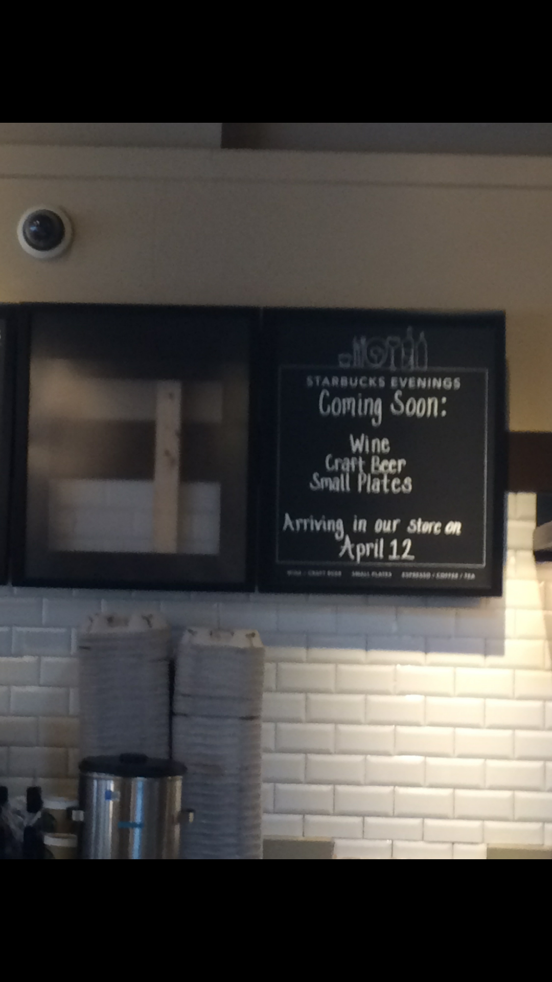 A menu board in the Starbucks at 1 Wall St. in Huntington village announces that the coffee shop will start serving booze as of April 12.