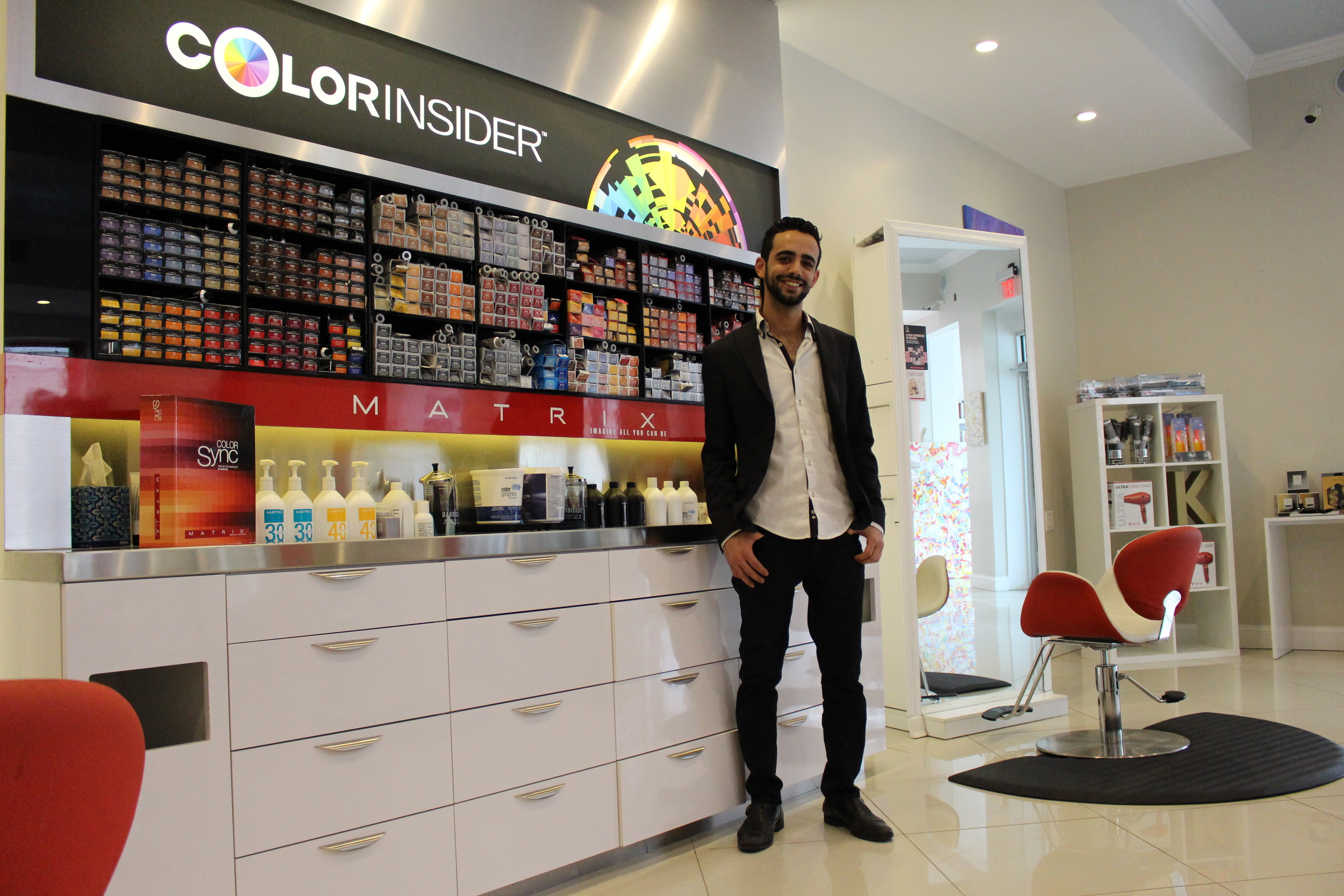 Standing next the salon's Matrix color station, Salon Mayan Owner and Creative Director Ben Aharon said he followed his dream of becoming a hair stylist and has since taken Huntington village, and the world of cosmetology, by storm.
