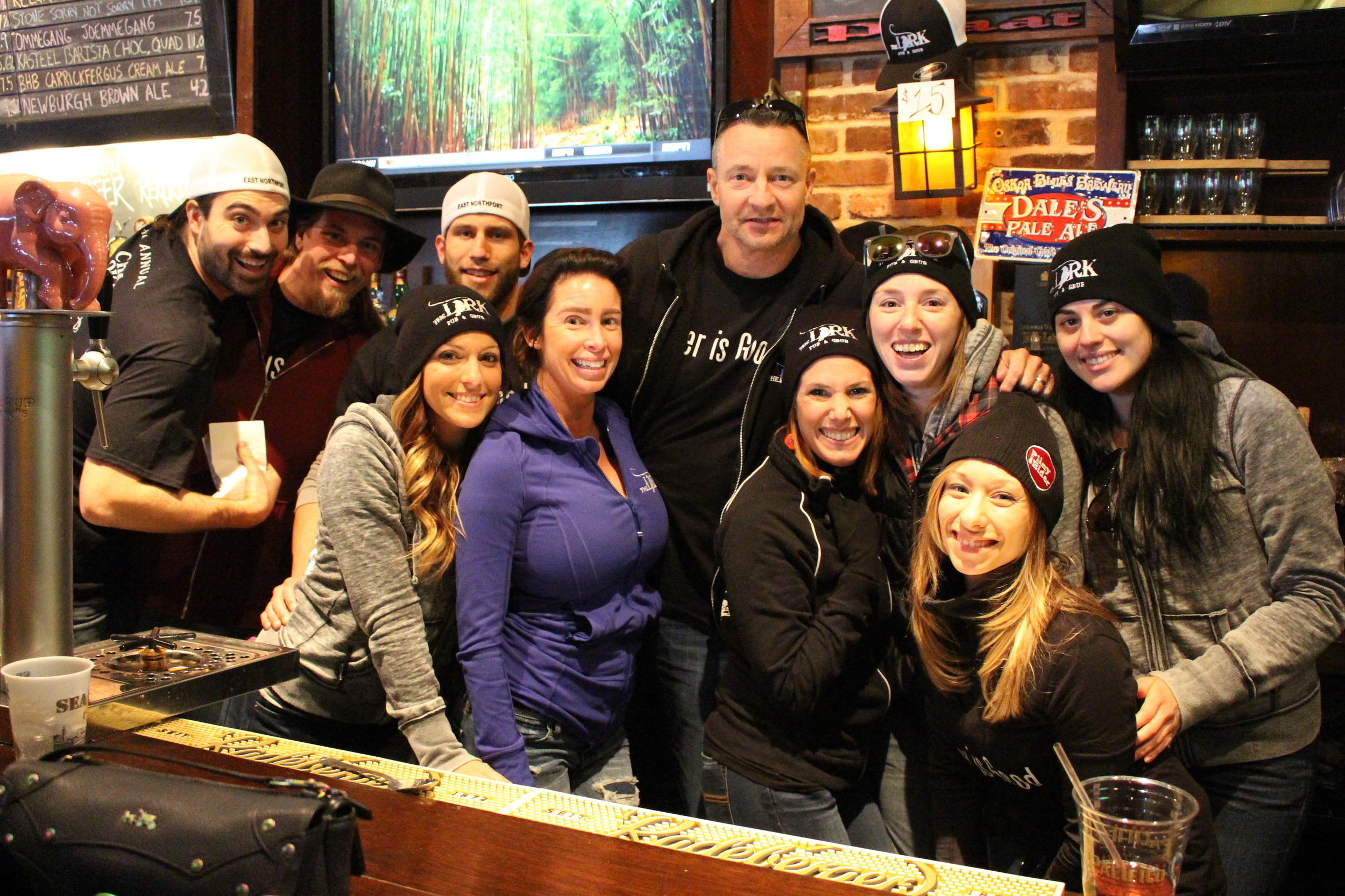 The Lark Pub & Grub staff members are all smiles during the pub's fourth annual chili cook-off on Sunday, which raised over $4,000 for The League for Animal Protection of Huntington.