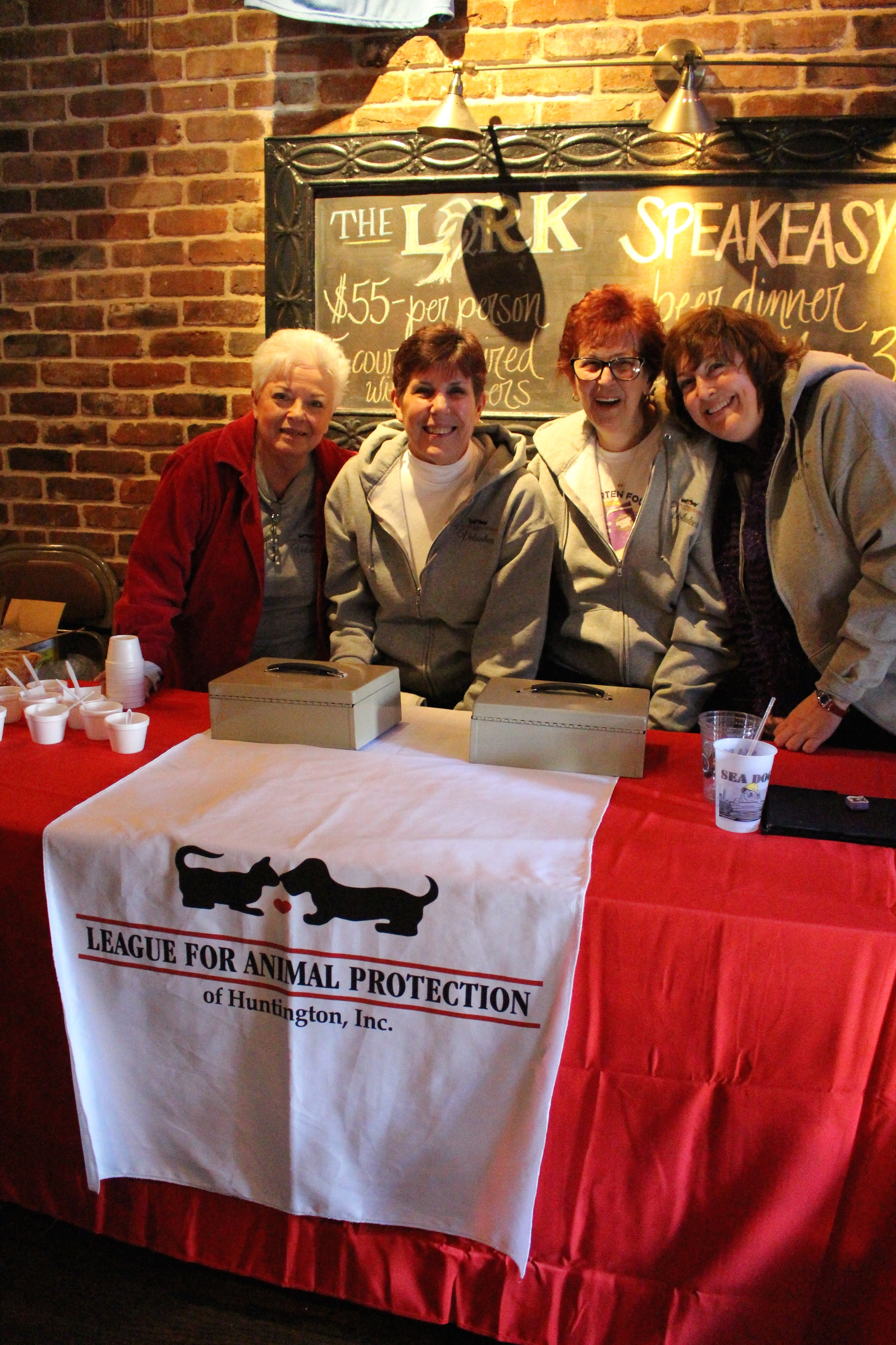 Members of The League for Animal Protection of Huntington are stationed at the front of The Lark Pub & Grub to collect donations during the fourth annual chili cook-off.