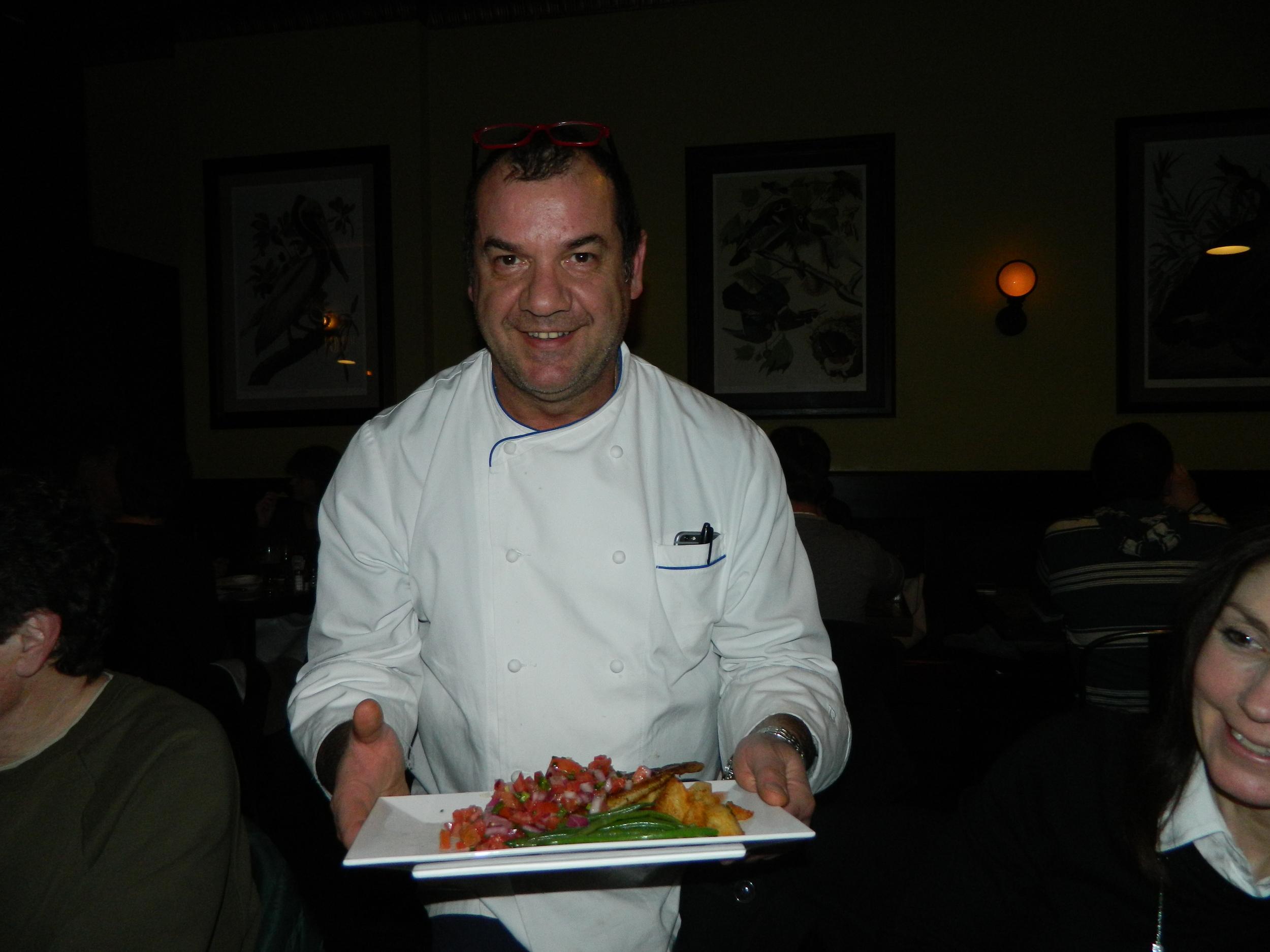 Owner and Executive Chef Nino Antuzzi presents blackened catfish.