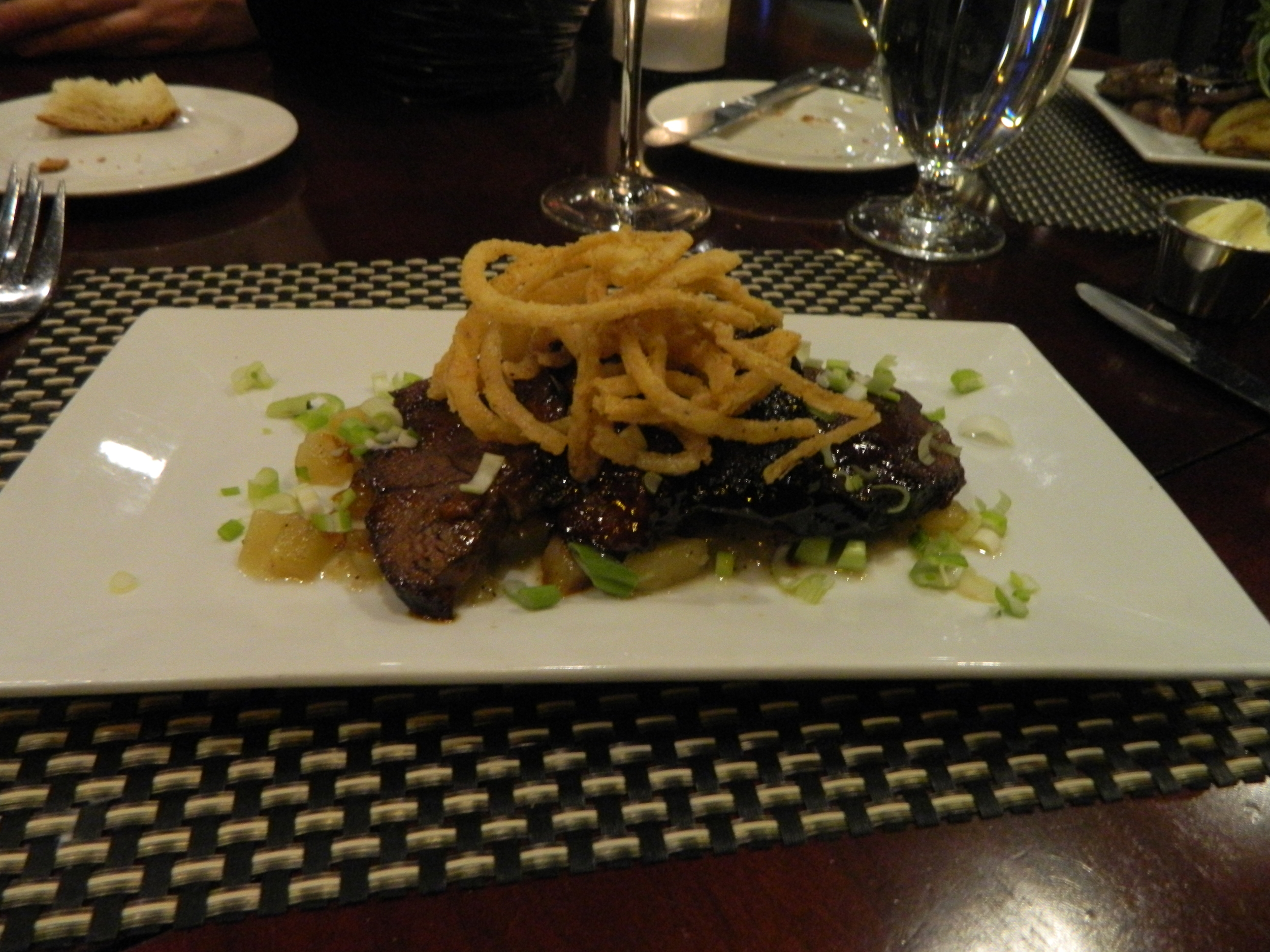 The Asian lacquered short ribs at Black & Blue are perfectly marinated and fall off the bone.