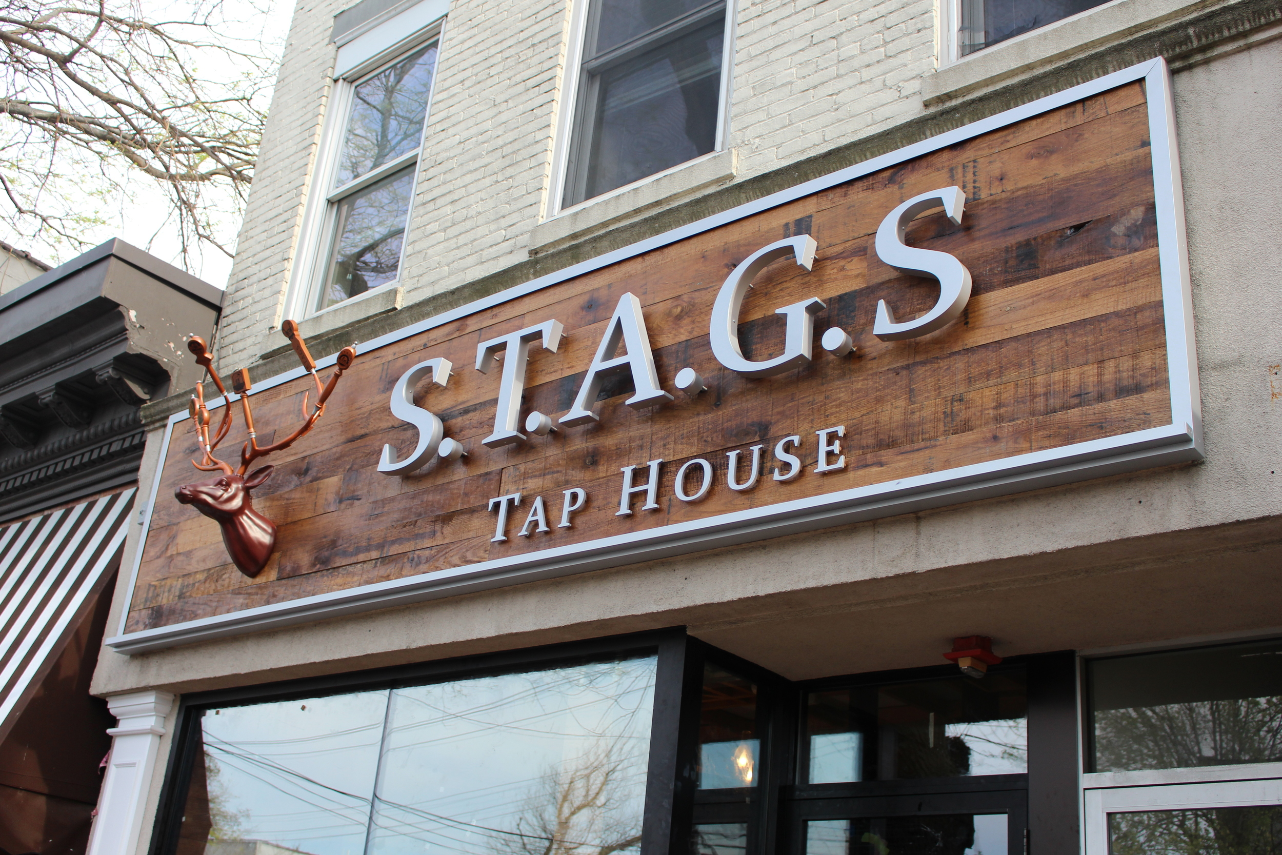 The newly-installed marquee above soon-to-be-open S.T.A.G.S. Tap House in Huntington village was custom-made by Huntington Station-based Signarama.