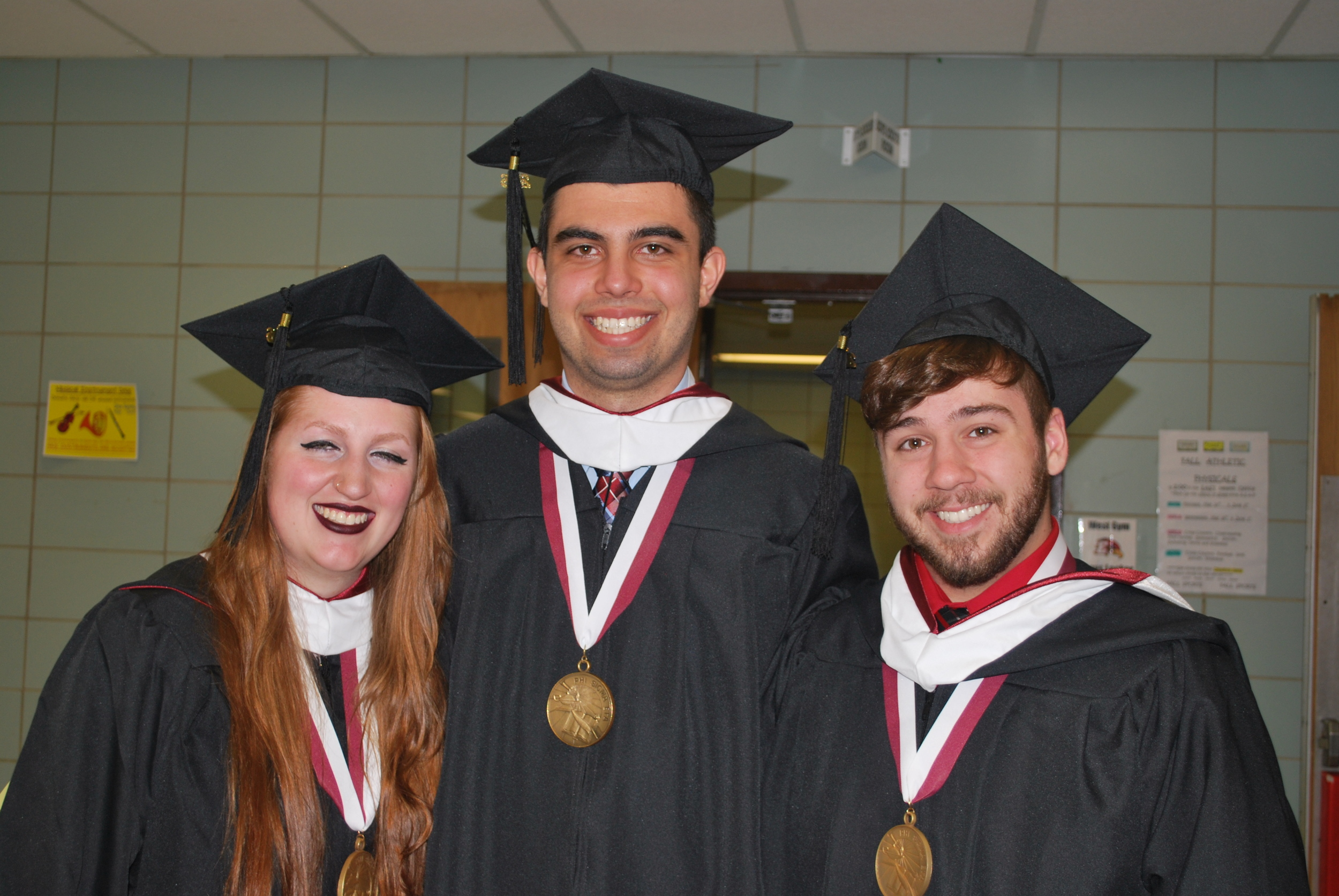 Five Towns recognized Valedictorian Melanie Magri, left, and Salutatorian Michael Makowski, center, are pictured with Kyle Young, a recipient of the Provost's Award for outstanding academic achievement.