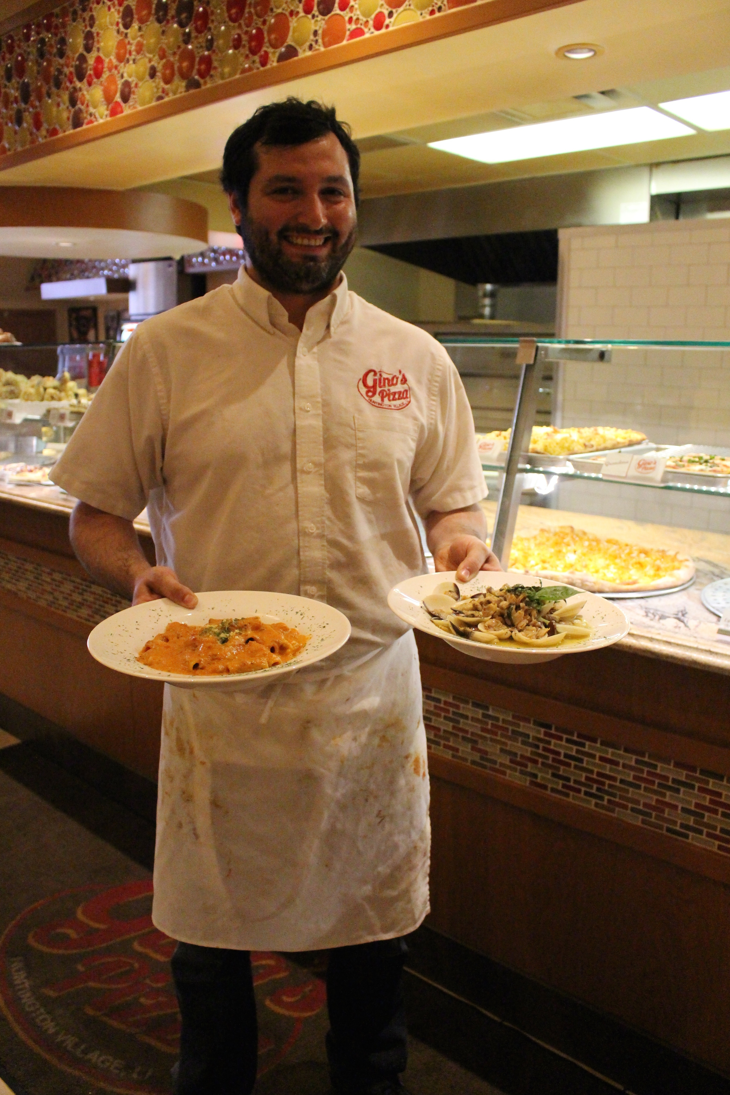 Nick Salerno, owner of Gino's Pizzeria in Huntington village, serves up rigatoni Bolognese with red wine sauce and linguini in white clam sauce.