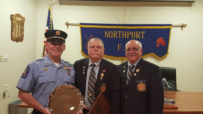 Volunteer firefighter John McKenna receives the Fire Service Community Achievement Award Monday night at the Northport Fire Department.   Photo/FASNY