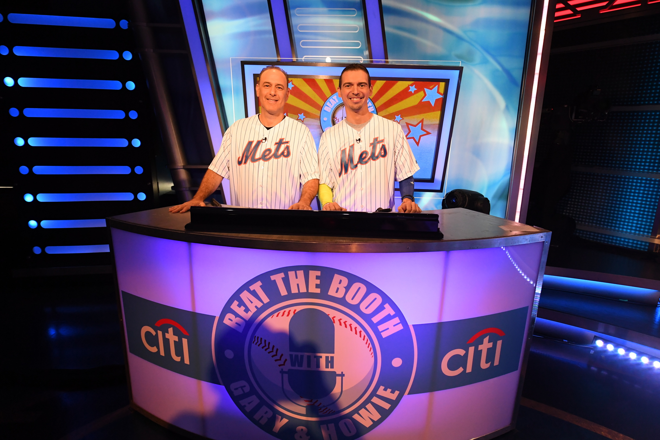"""Adam Yanover, left, of Melville, is pictured on the set of trivia game show """"Beat the Booth"""" with teammate Anthony Furia, of Brooklyn."""