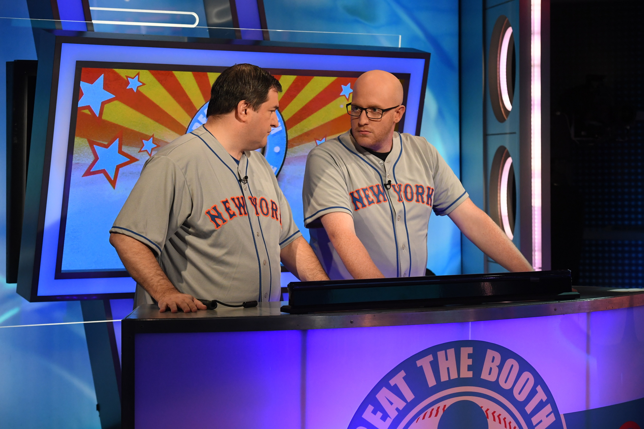 """James Hawkins, right, of East Northport, and Andrew Padaetz, of Brooklyn, talk things over on trivia game show """"Beat the Booth."""""""