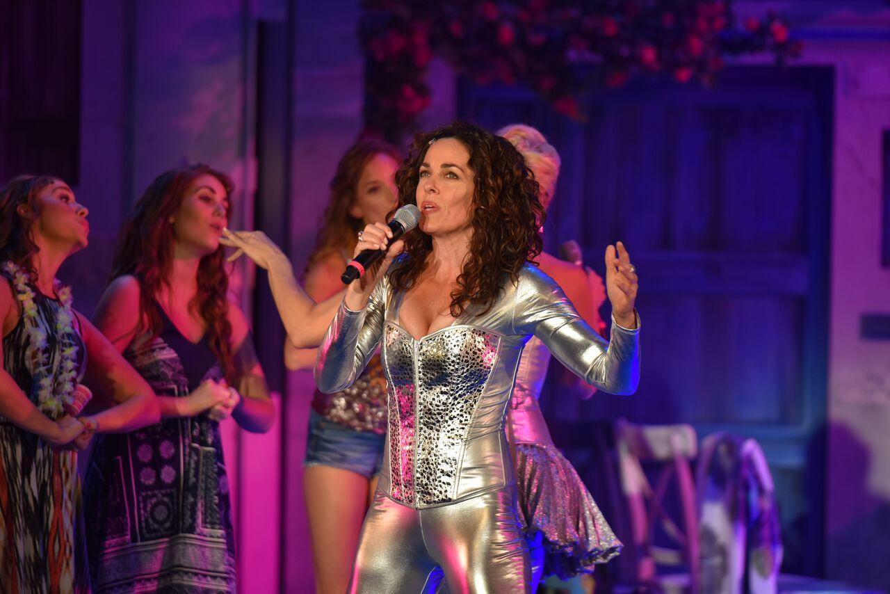 "Michelle Dawson (as Donna Sheridan) singing ""Super Trouper"" in the John W. Engeman Theater production of ""Mamma Mia!"""
