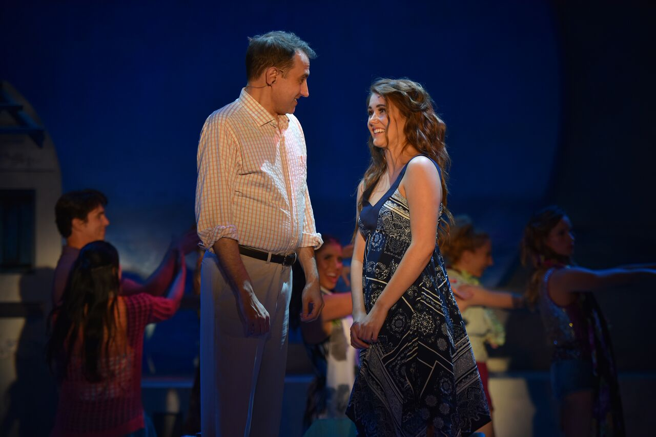"""Frank Vlastnik (as Harry) pulls Hannah Slabaugh (as Sophie) aside during """"Gimme! Gimme! Gimme!"""" and asks her why she invited him back to the island the day before her wedding."""