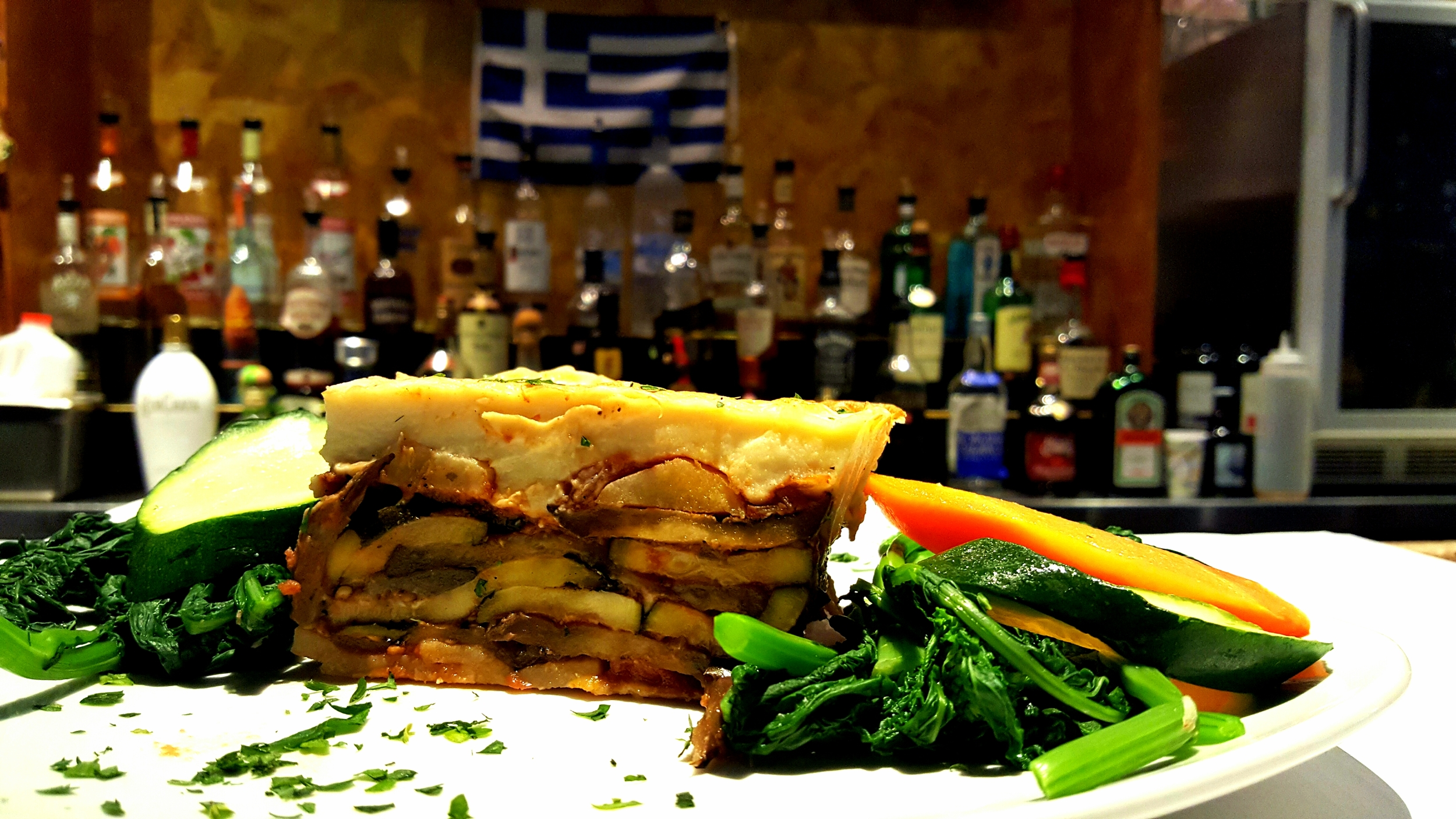A vegetarian favorite, Neraki's Moussaka is made with eggplant and zucchini over potatoes.