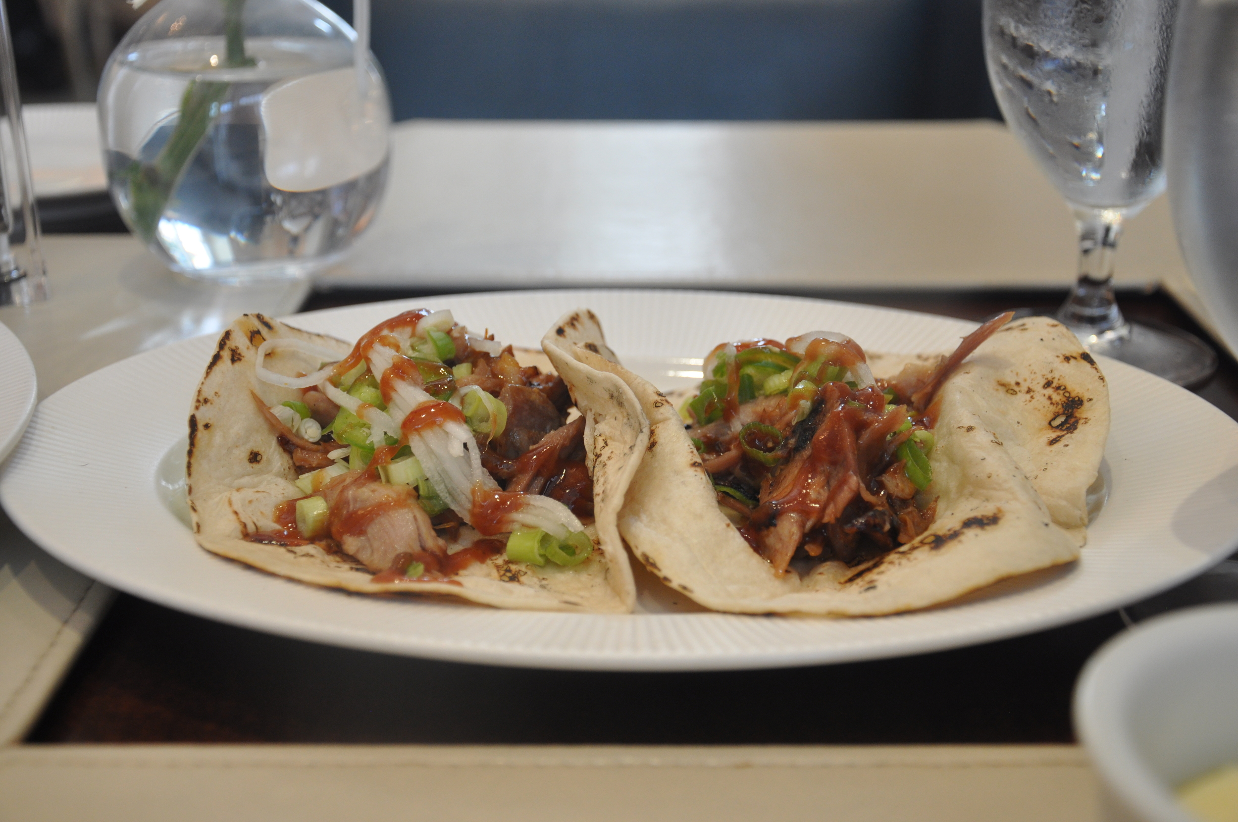Sandbar's duck tacos are filled with pulled duck, daikon, and jalapeno and topped with hoisin sauce.