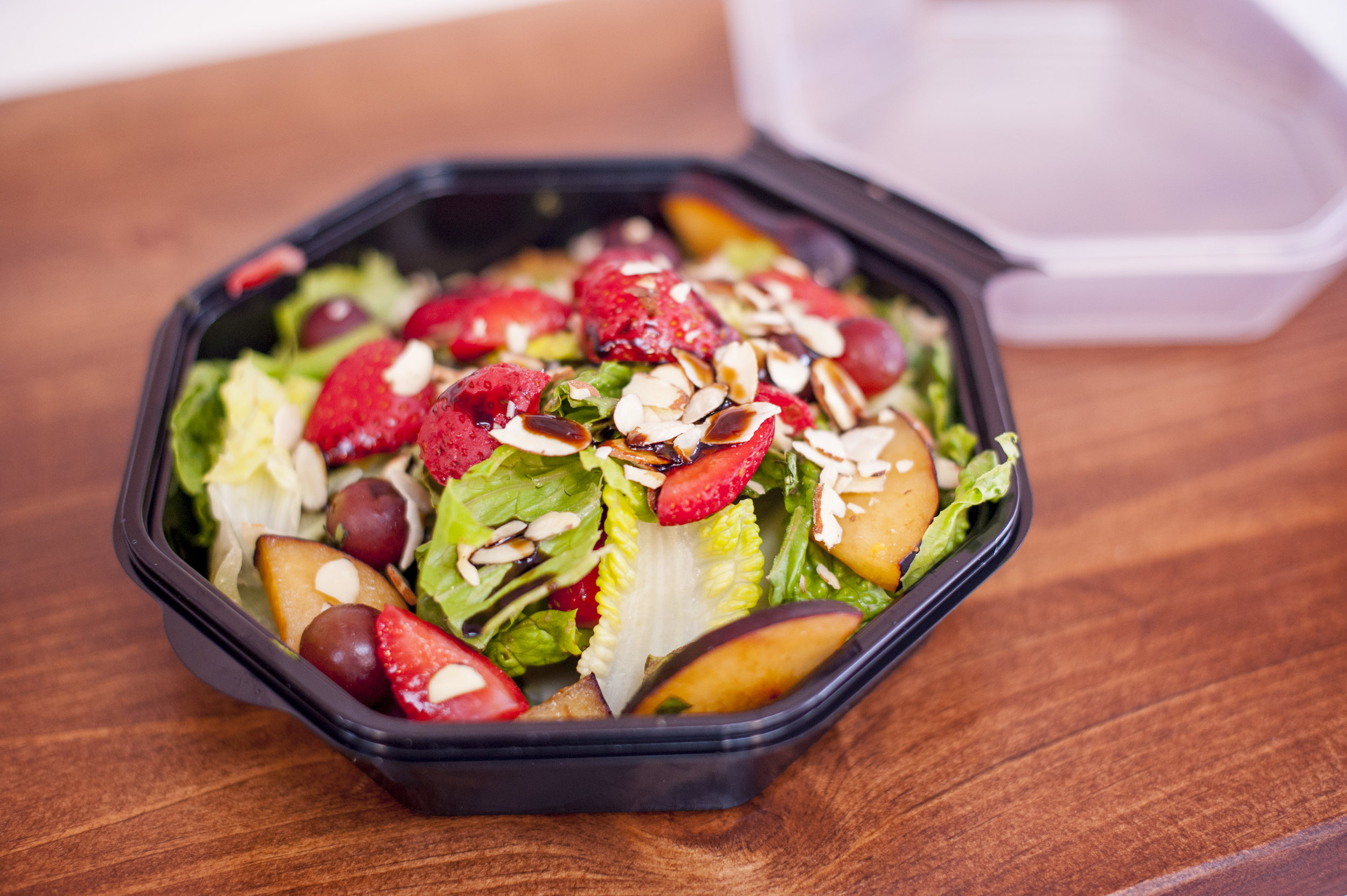 Start your course with a Spring Salad, bursting with the fruity flavors of plums, strawberries and grapes.