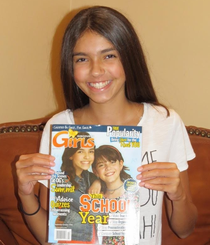 Thirteen-year-old Dix Hills resident Victoria Albanese is featured in the September/October 2016 issue of Discovery Girls Magazine, which she is pictured holding.