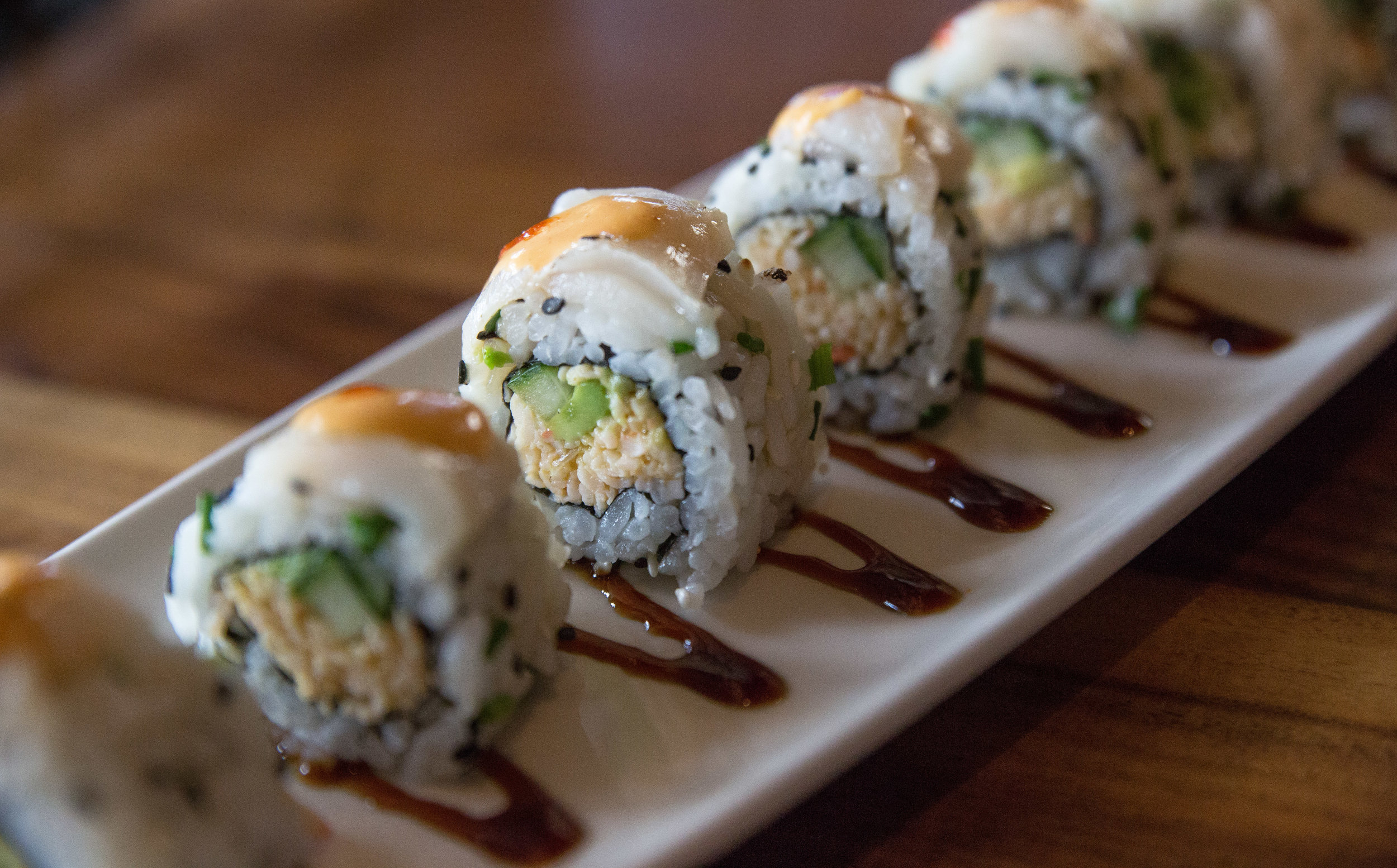 Long Islander News photos/Craig D'Andrea    The Dynamite Scallp Roll at P.F. Chang's in Melville is wrapped around a creamy kani kama, topped with seared scallops.