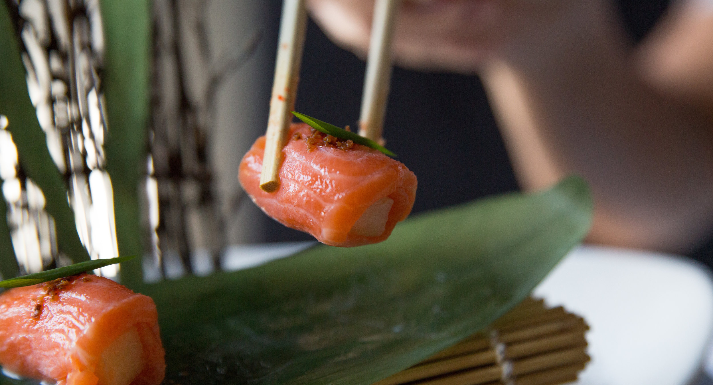 Long Islander News photos/Jano Tantongco  A deliciously decadent appetizer, the King Salmon Nashi ($18) wraps wild salmon around crunchy Asian pears and is topped with truffle salt, dried miso, yuzu citrus sauce.