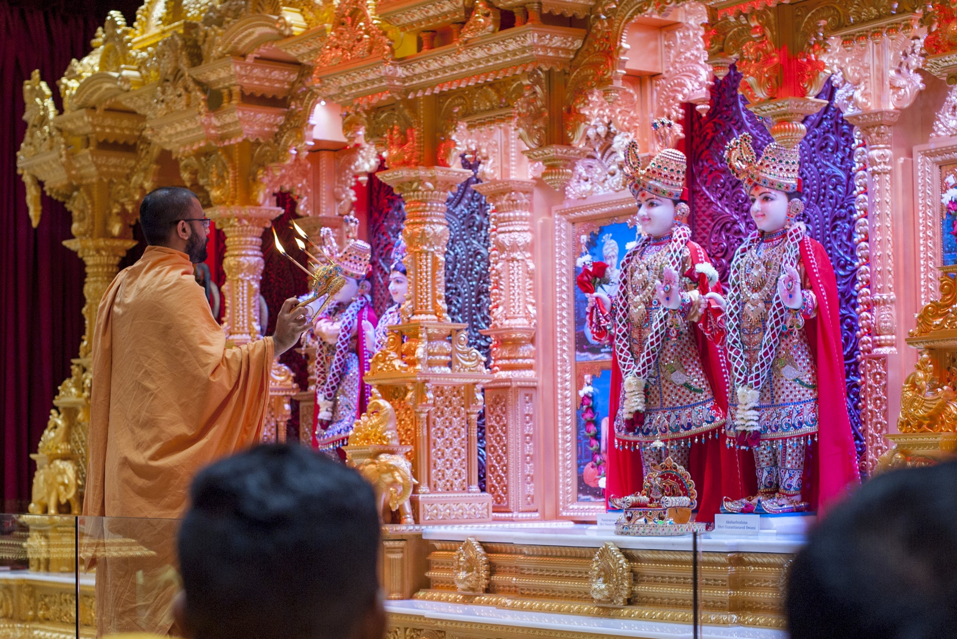 During an evening Arti, the Hindu ceremony of light, attendees clapped and chanted mantras in praise of their guru.