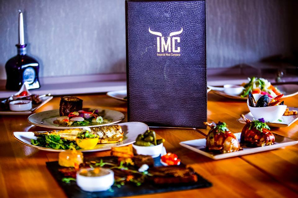 IMC Restaurant & Bar has debuted its new fall menu, which features appetizers like maple glazed bacon and entrées like lamp chops.