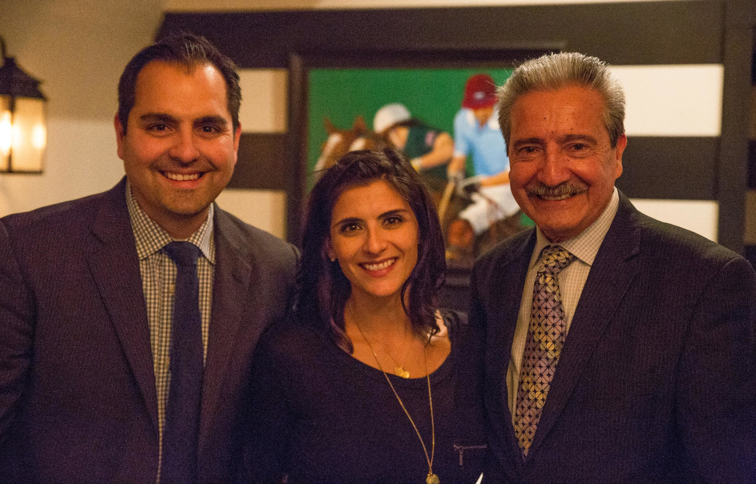Cafe Buenos Aires owner Hugo Garcia, right, poses with son Gabriel Garcia and daughter Vanessa Long, who help him run the restaurant.